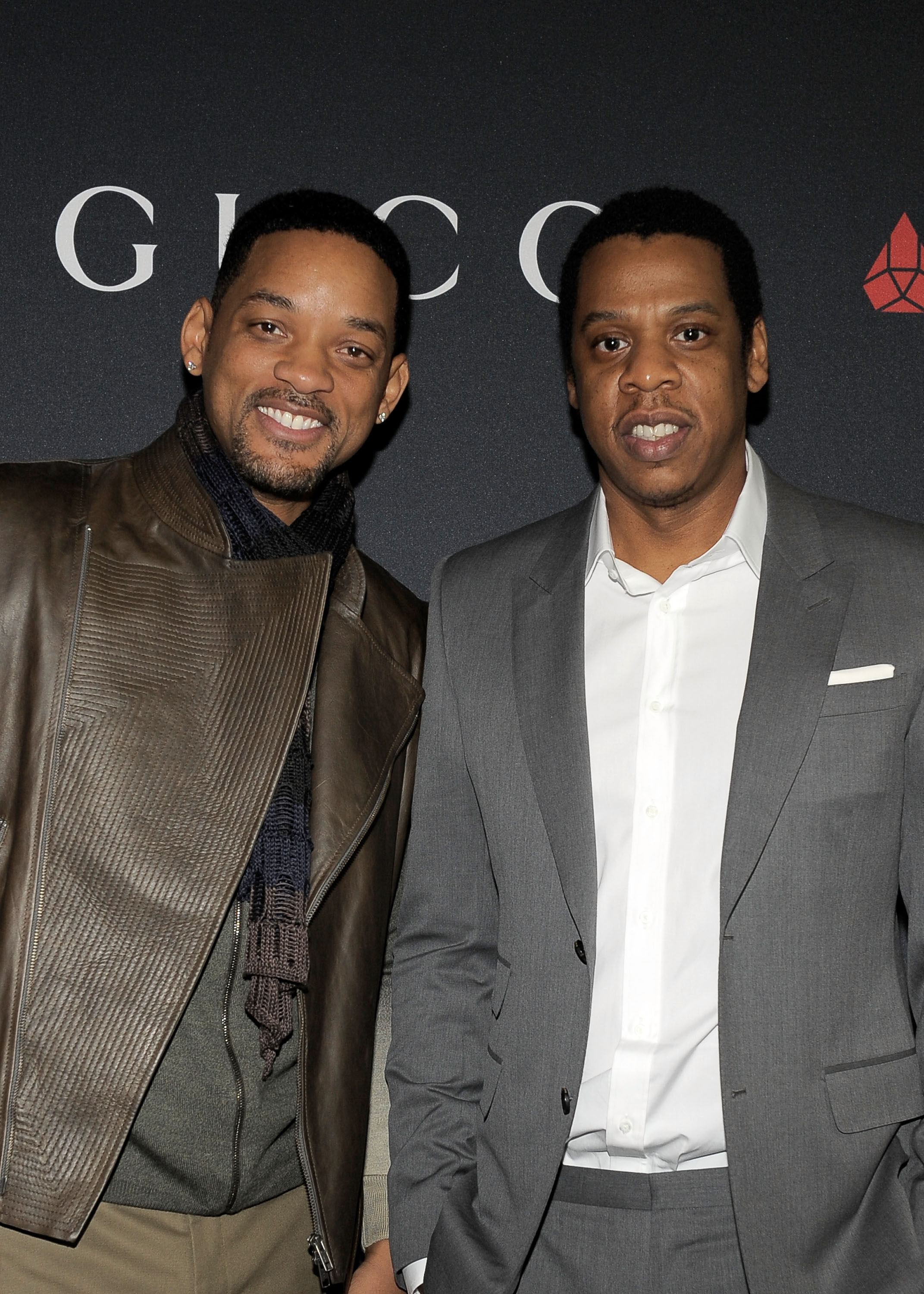 Actor Will Smith (L) and Rapper Jay-Z arrive at the Gucci and RocNation Pre-GRAMMY brunch held at Soho House on February 12, 2011 in West Hollywood, California.