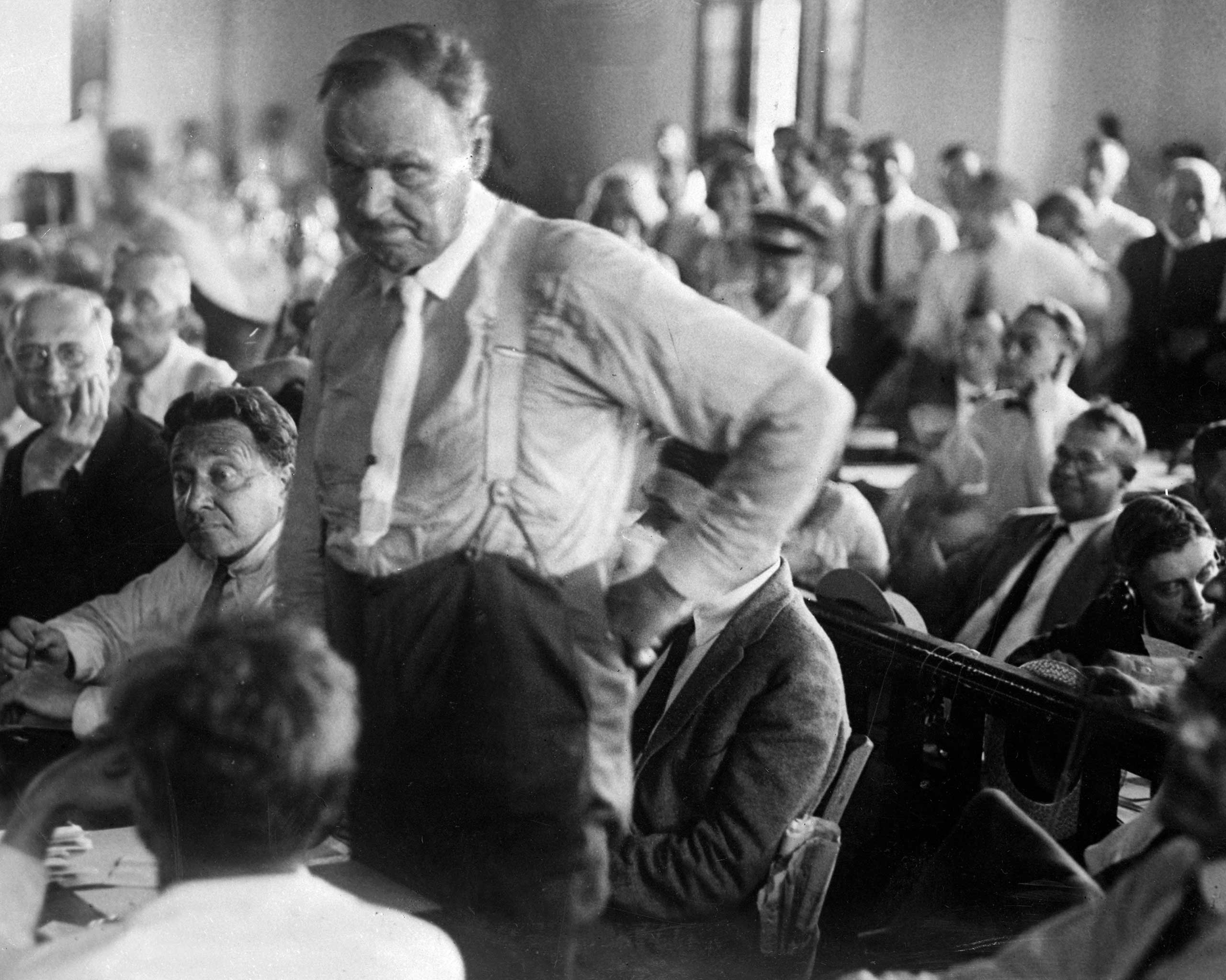 Attorney Clarence Darrow consults with Judge Raulston about procedure in the Tennessee courts during the trial of John T. Scopes.