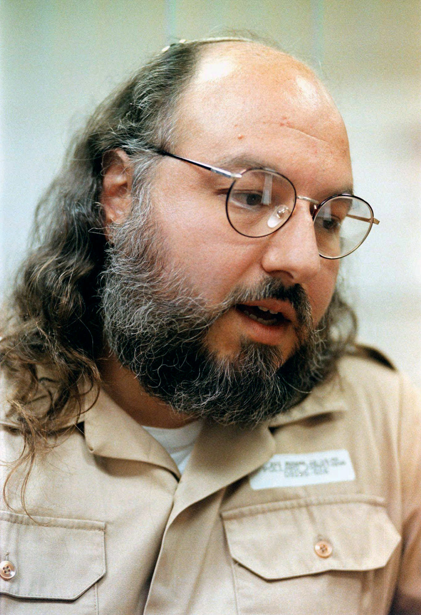 In this May 15, 1998 file photo, Jonathan Pollard speaks during an interview in a conference room at the Federal Correctional Institution in Butner, N.C.
