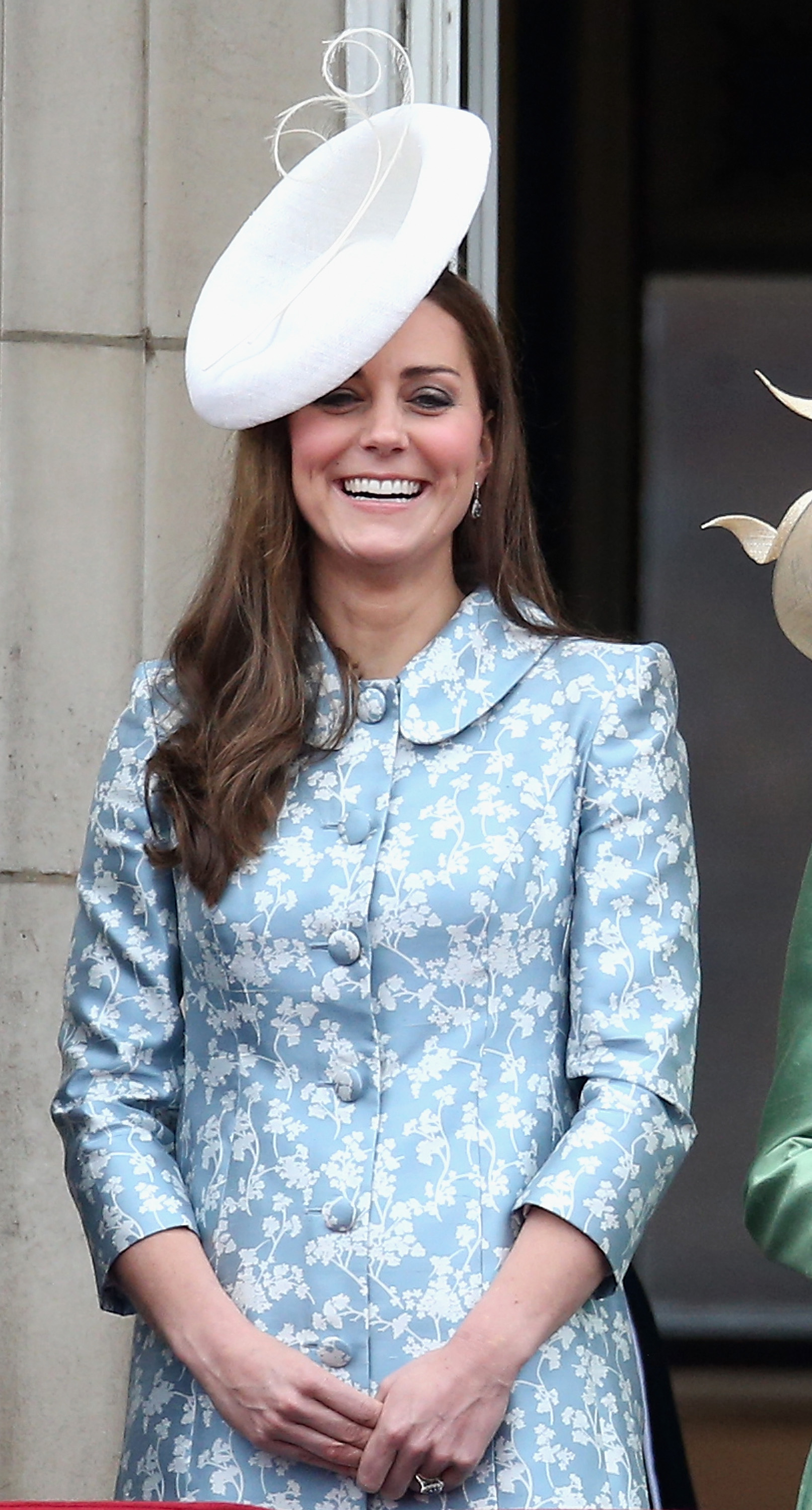 Catherine, Duchess of Cambridge laughs on the balcony of Buckingham Palace during the Trooping the Colour on June 13, 2015 in London.