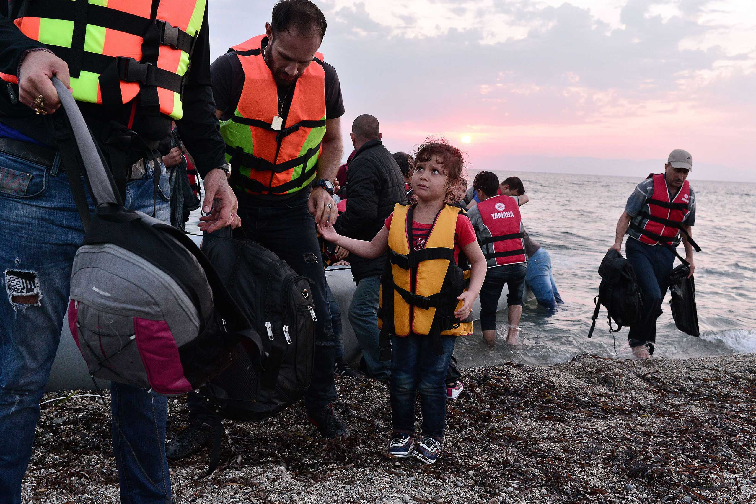 Syrians disembark on the island of Lesbos, Greece, early on June 18, 2015.