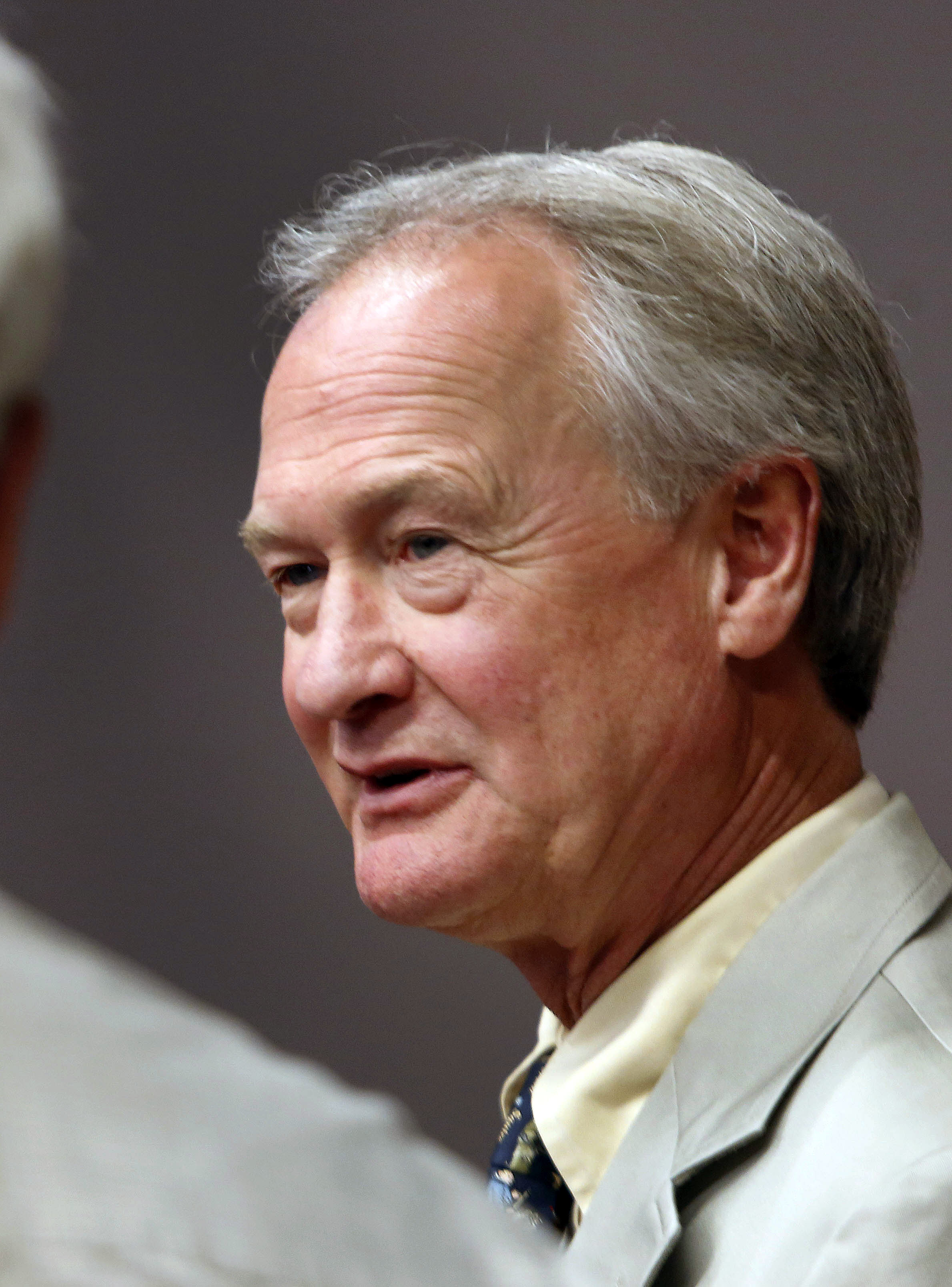 Democratic presidential candidate former Rhode Island Gov. Lincoln Chafee meets with voters during a campaign stop in Laconia, N.H.