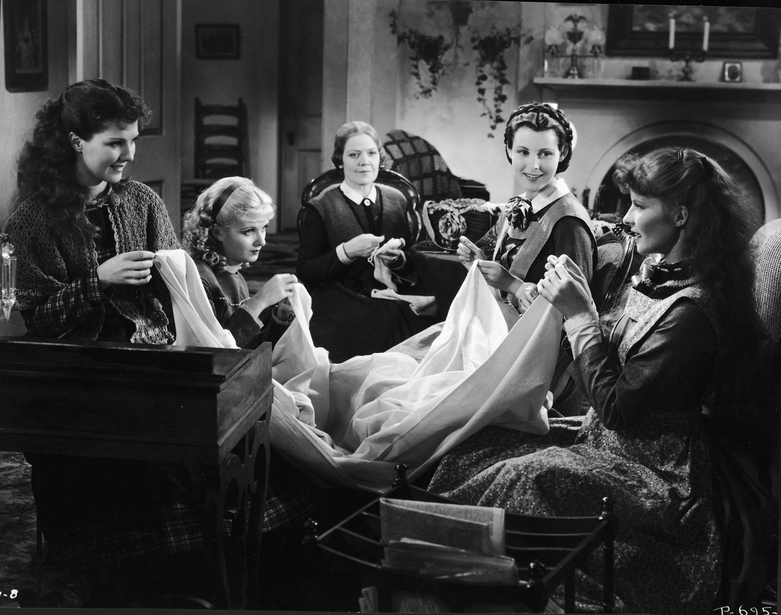 American actresses Jean Parker, Joan Bennett, Spring Byington, Frances Dee, and Katharine Hepburn as the March women in a still from an adaptation of Louisa May Alcott's book 'Little Women' directed by George Cukor, 1933.