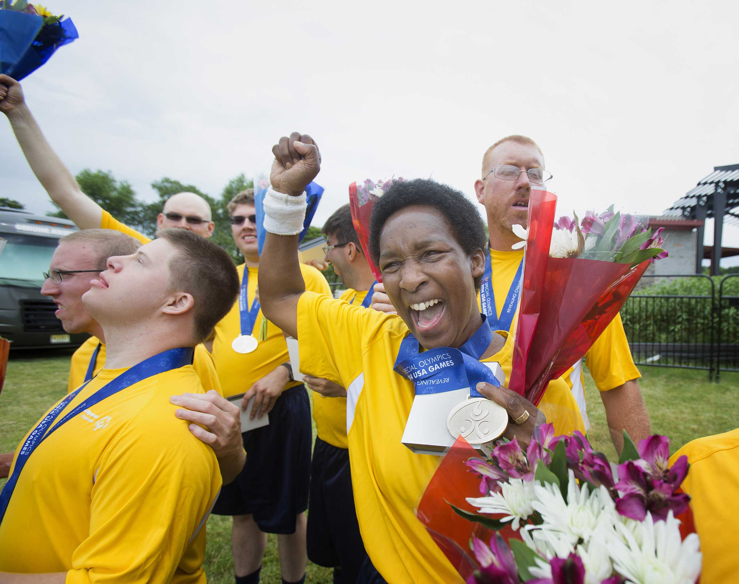 Goalie Loretta Claiborne, right, and her teammates on Pennsylvania's Traditional 5V5 Division 3 Special Olympics soccer team celebrate their 4-1 victory over Michigan in Hamilton Township, N.J., on June 19, 2014.
