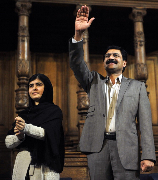 Malala Yousafzai and her father Ziauddin Yousafzai at the first Global Citizenship Commission in Scotland on Oct. 19, 2013.