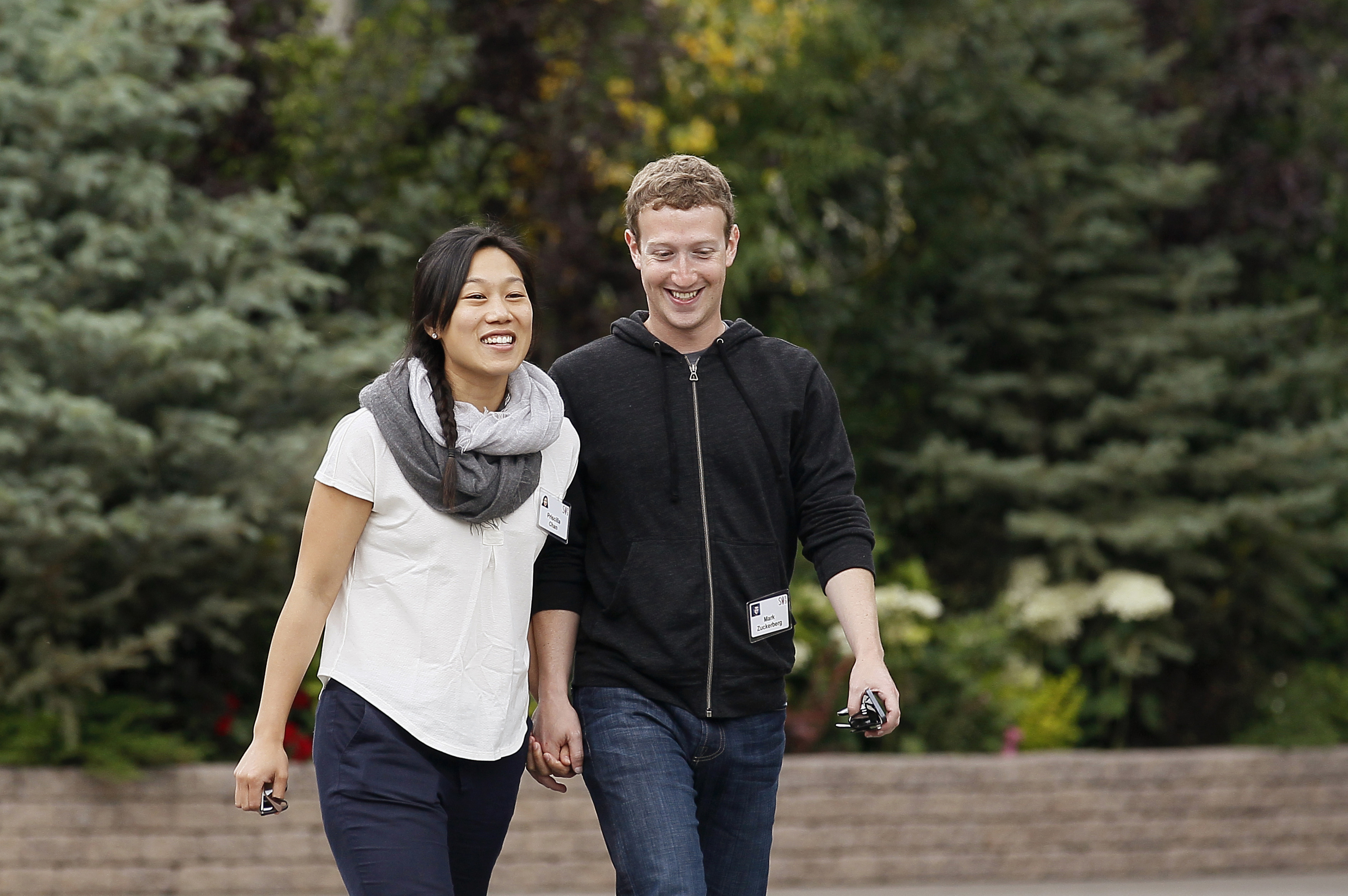 Facebook CEO Mark Zuckerberg walks with his wife Priscilla Chan at the annual Allen and Co. conference at the Sun Valley, Idaho Resort on July 11, 2013.