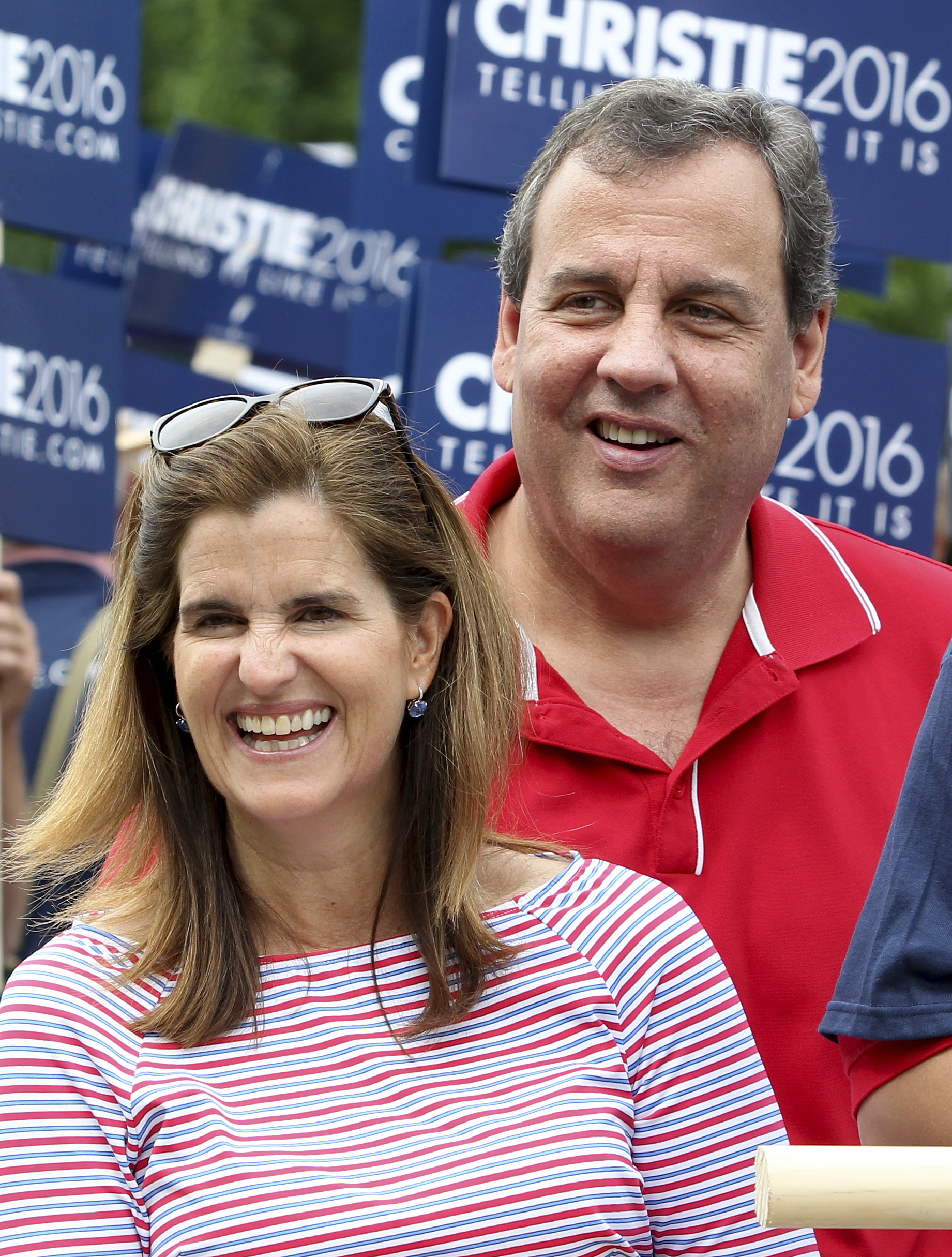 Republican presidential candidate New Jersey Gov. Chris Christie and his wife wife Mary Pat walk in the Fourth of July parade  in Wolfeboro, N.H.