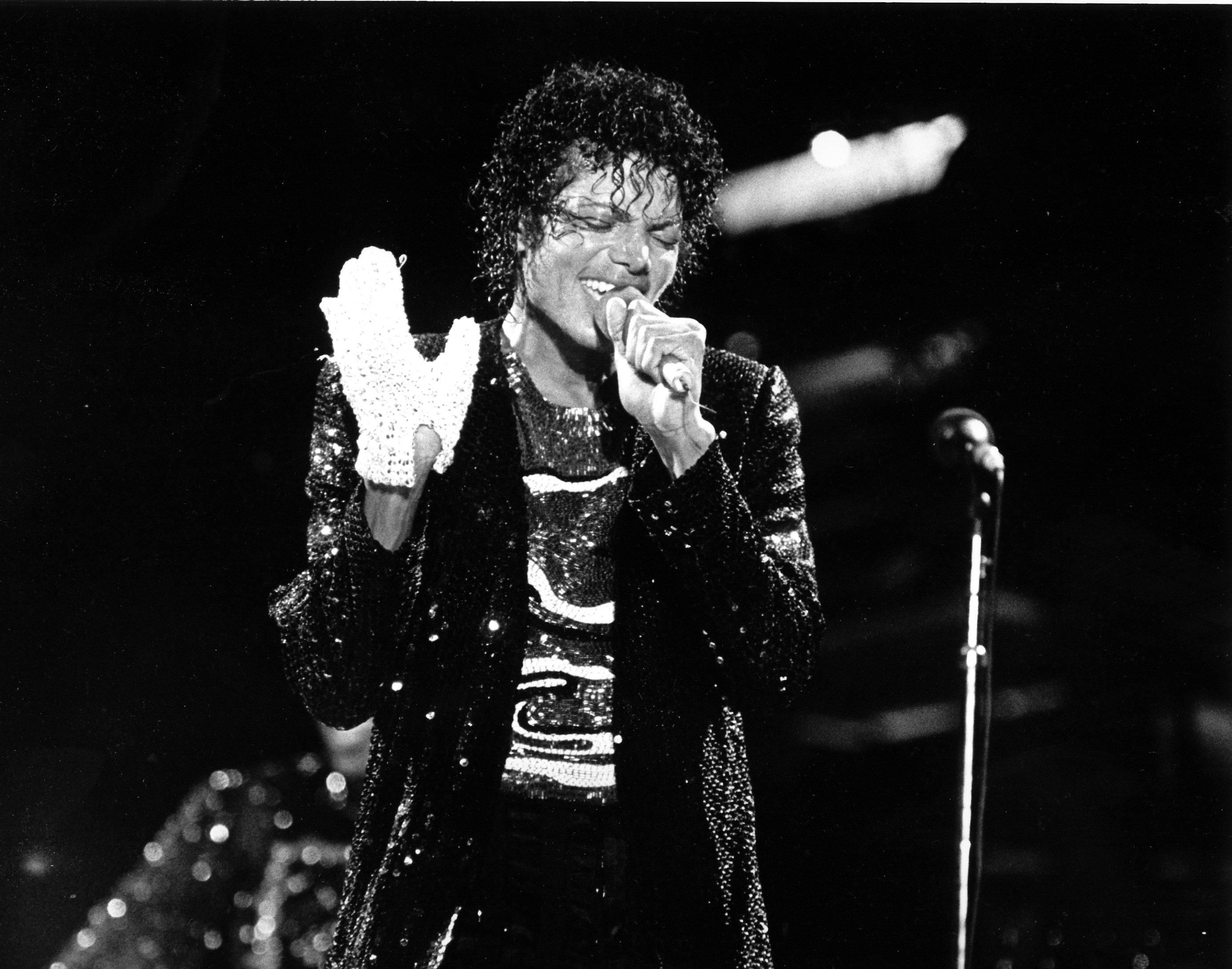 In this July 7, 1984 file photo, Michael Jackson wears a white glove during his performance kicking off the  Victory Tour  at Arrowhead Stadium in Kansas City, Mo.