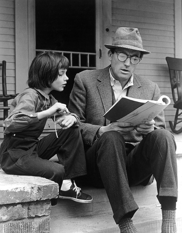 Gregory Peck and Mary Badham review the script for the film, 'To Kill a Mockingbird' directed by Robert Mulligan, on the set of the film.