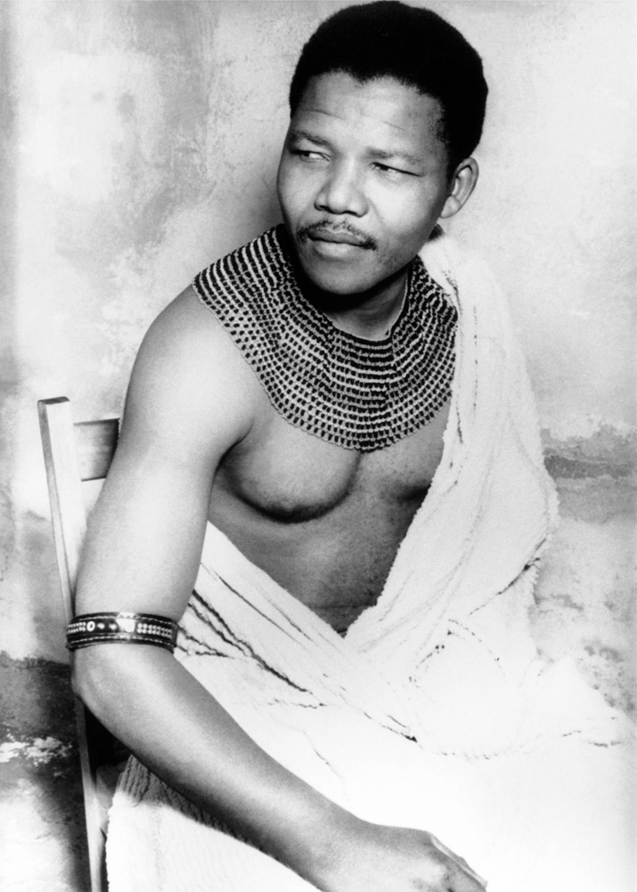 "Mandela was born on July 18, 1918, in the village of Mviza in South Africa's Eastern Cape. His father was a counselor to a local king. He chose for his son the name Rolihlahla, which translated from Xhosa means literally ""pulling a branch off a tree"" — or, more colloquially, ""troublemaker."" A schoolteacher would confer upon him the name Nelson."