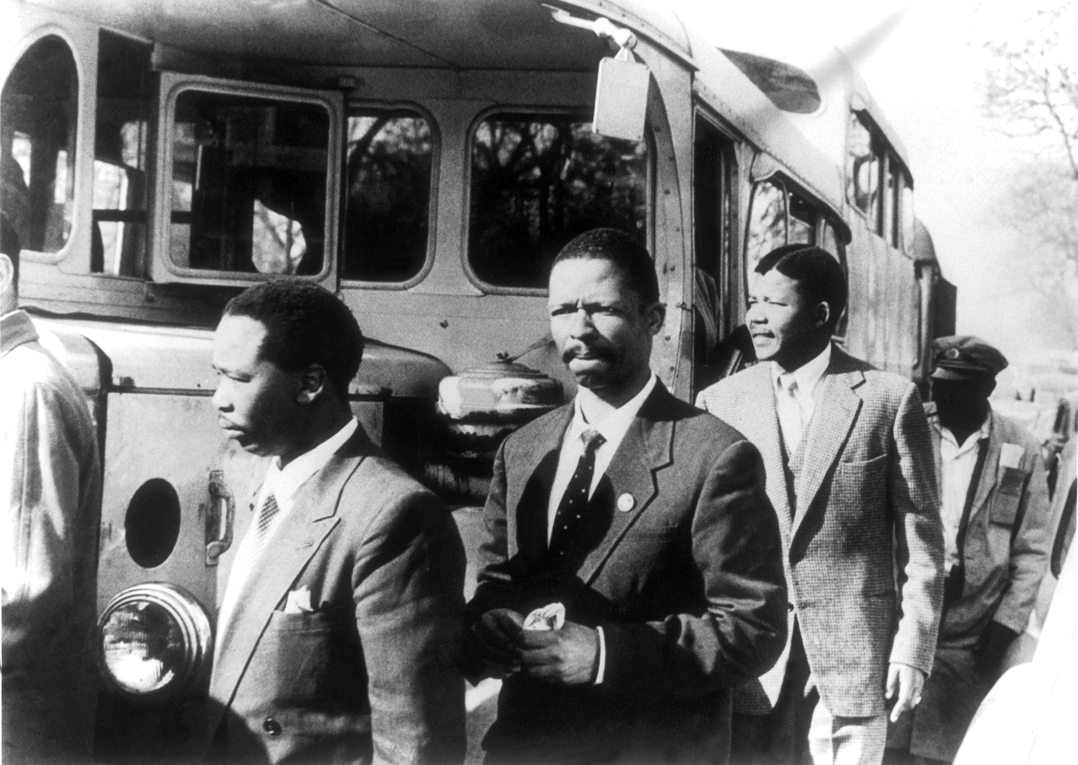 Mandela and other co-defendants appear at the famous Treason Trial in Johannesburg, 1956. Mandela, along with his longtime ally Oliver Thambo and 154 others, was charged with treason. The case, which dragged on for five years, by which time all were acquitted, brought the struggle of the ANC to international attention.