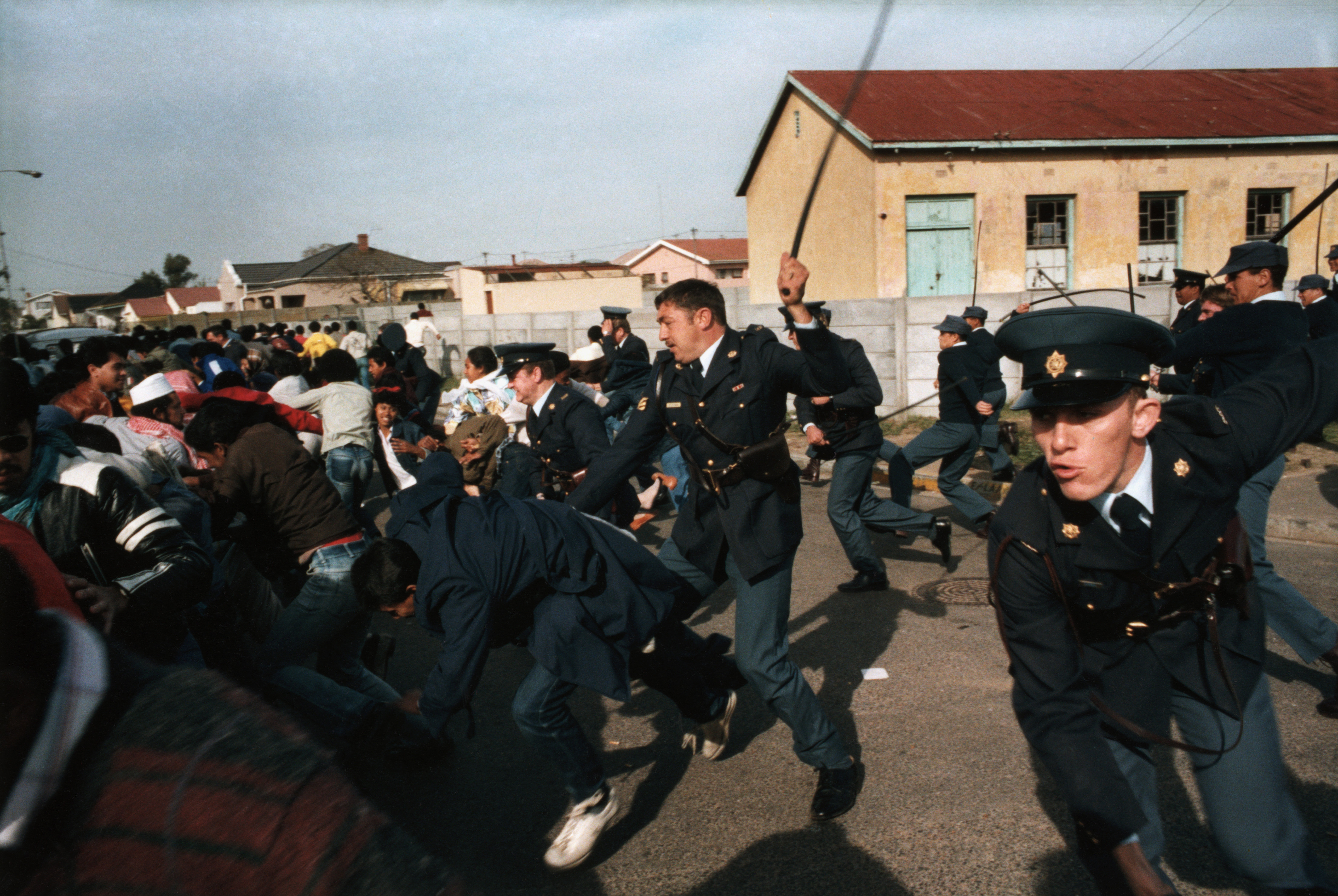 In the Athlone neighborhood of Cape Town, regime police use horsewhips against protesters demonstrating in support of the jailed Mandela. Ruthless crackdowns, mass protests and bouts of insurgent violence across the country's townships captured world attention and generated international support against the apartheid state.