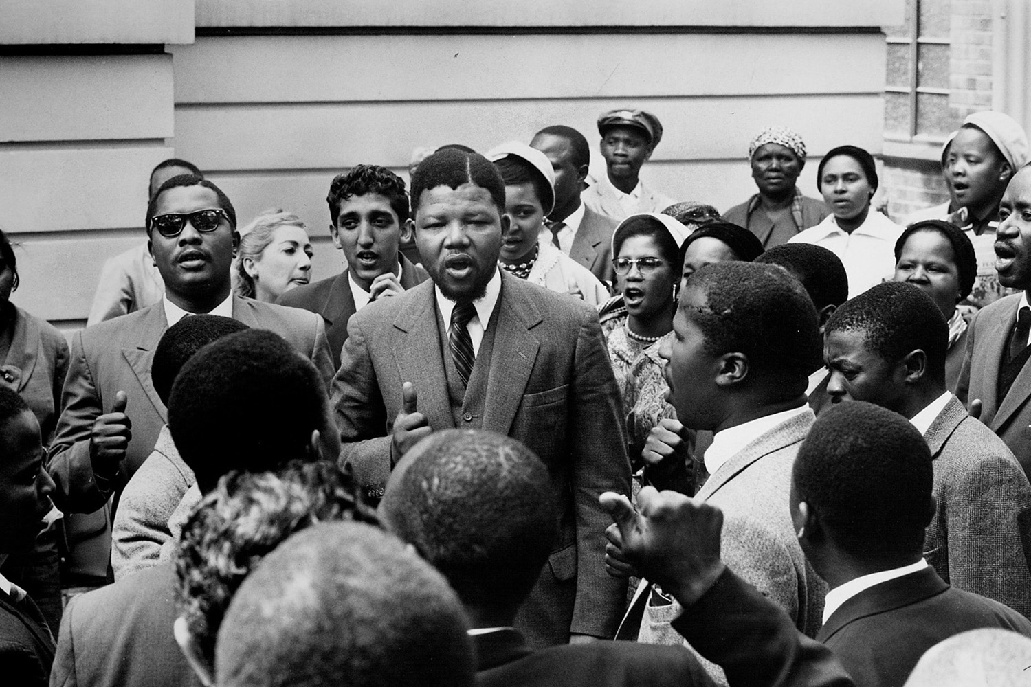 Mandela, center, stands amid a gathering of other co-defendants during the Treason Trial.