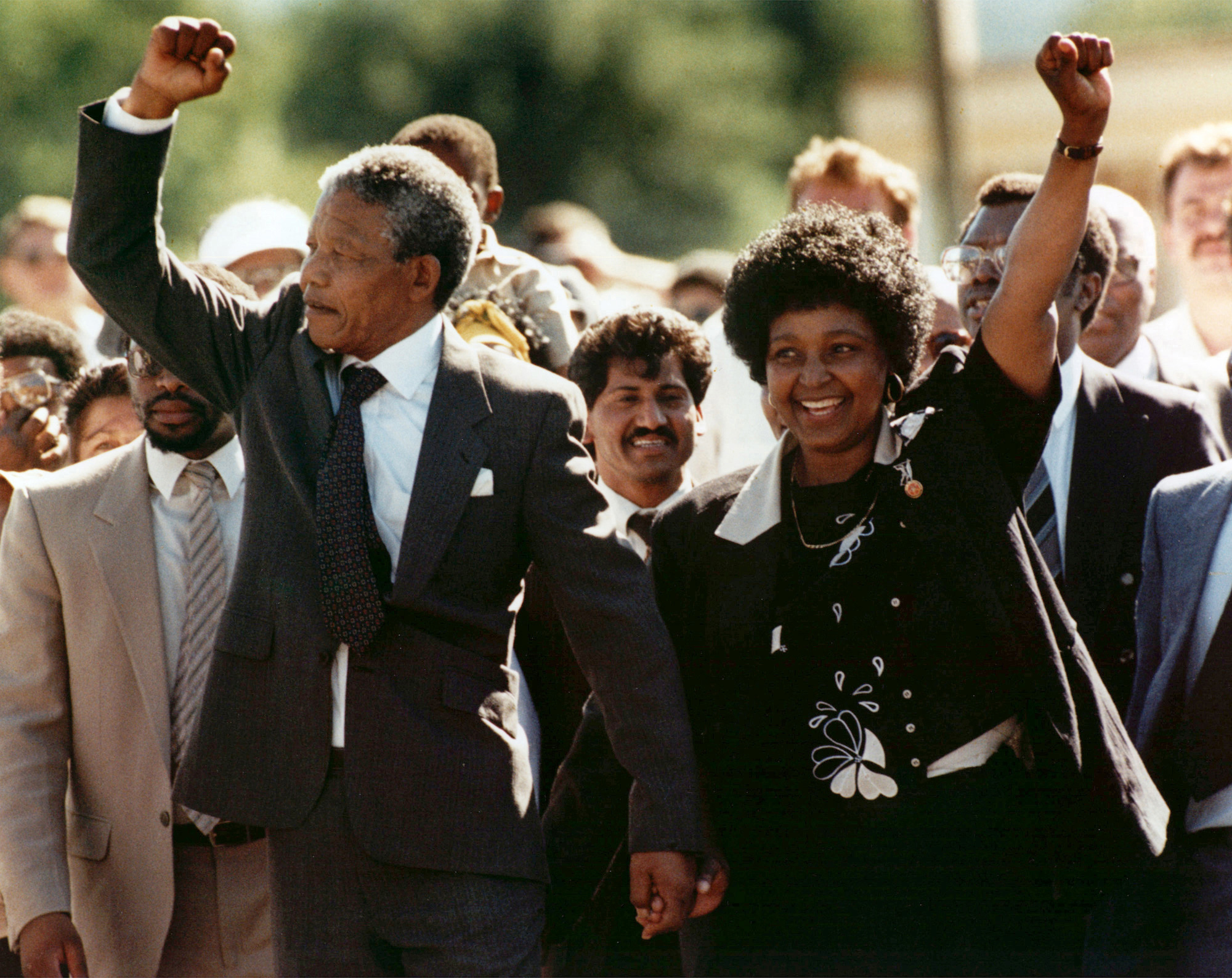 Mandela walks with his wife Winnie after being released from prison, Feb. 11, 1990.
