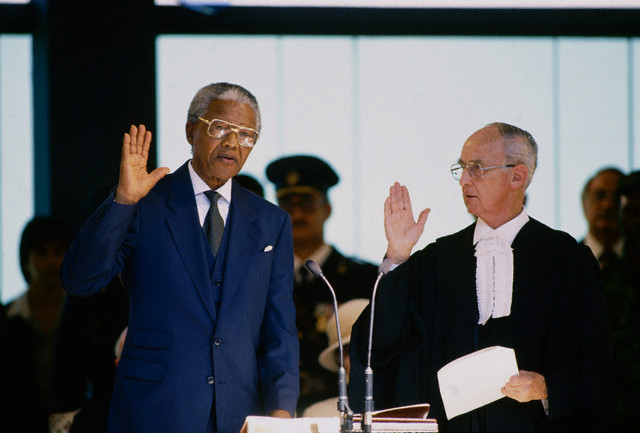 Mandela, 75, takes the oath of office in the political capital Pretoria as the first democratically elected President of South Africa. De Klerk, once an adversary, joined government as Mandela's deputy.