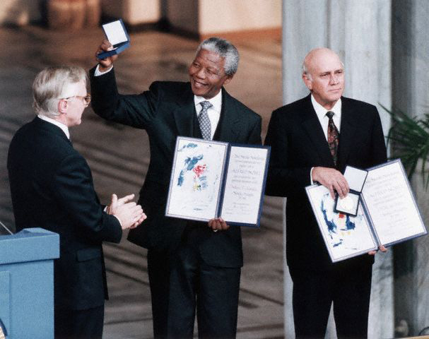 In 1993, Mandela is awarded the Nobel Peace Prize alongside then South African President F.W. de Klerk, whose rapprochement with Mandela and the ANC helped engineer the end of apartheid.