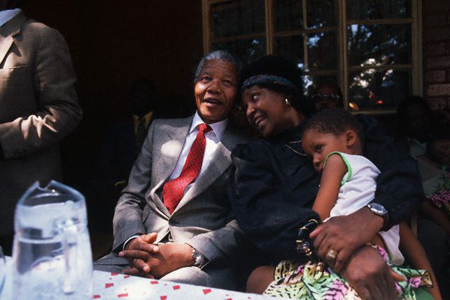 Nelson and Winnie Mandela watch a performance at a homecoming party after his release from prison. Feb 23, 1990.