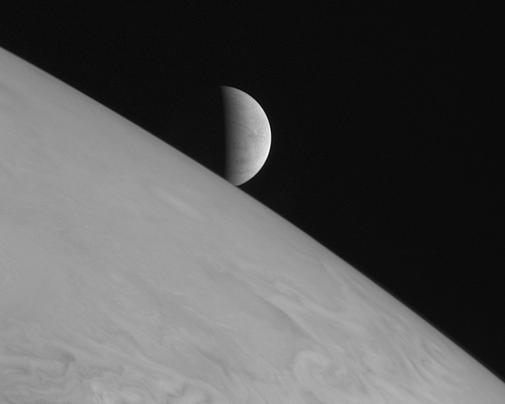 The icy moon Europa rising above Jupiter's cloud tops taken on Feb. 28, 2007, six hours after the spacecraft's closest approach to Jupiter.