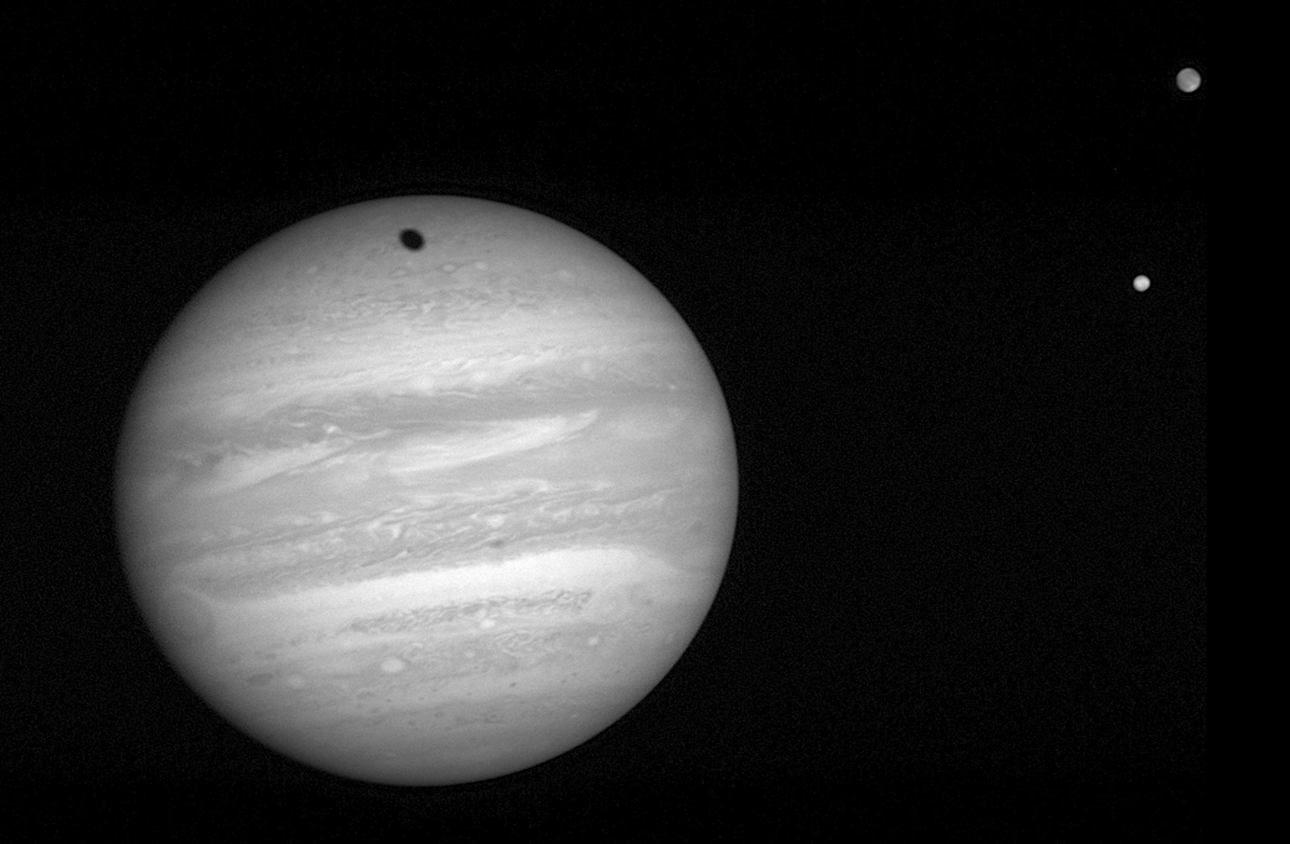 The New Horizons LORRI took this 2-millisecond exposure of Jupiter on Jan. 24, 2007. The spacecraft was 57 million kilometers (35.3 million miles) from Jupiter, closing in on the giant planet at 41,500 miles (66,790 kilometers) per hour. At right are the moons Io (bottom) and Ganymede; Ganymede's shadow creeps toward the top of Jupiter's northern hemisphere.