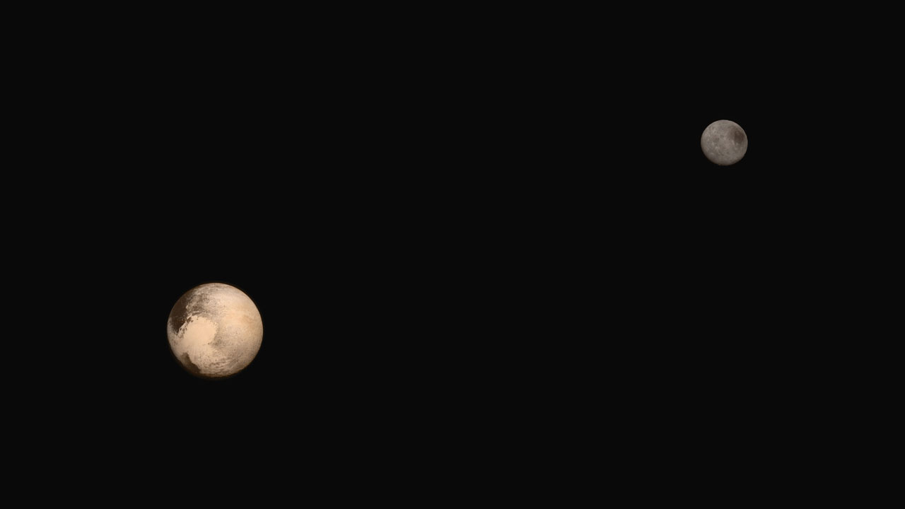 A composite image of Pluto and its largest moon Charon collected separately by New Horizons during approach on July 13 and July 14, 2015. The relative reflectivity, size, separation, and orientations of Pluto and Charon are approximated in this composite image, and they are shown in approximate true color.