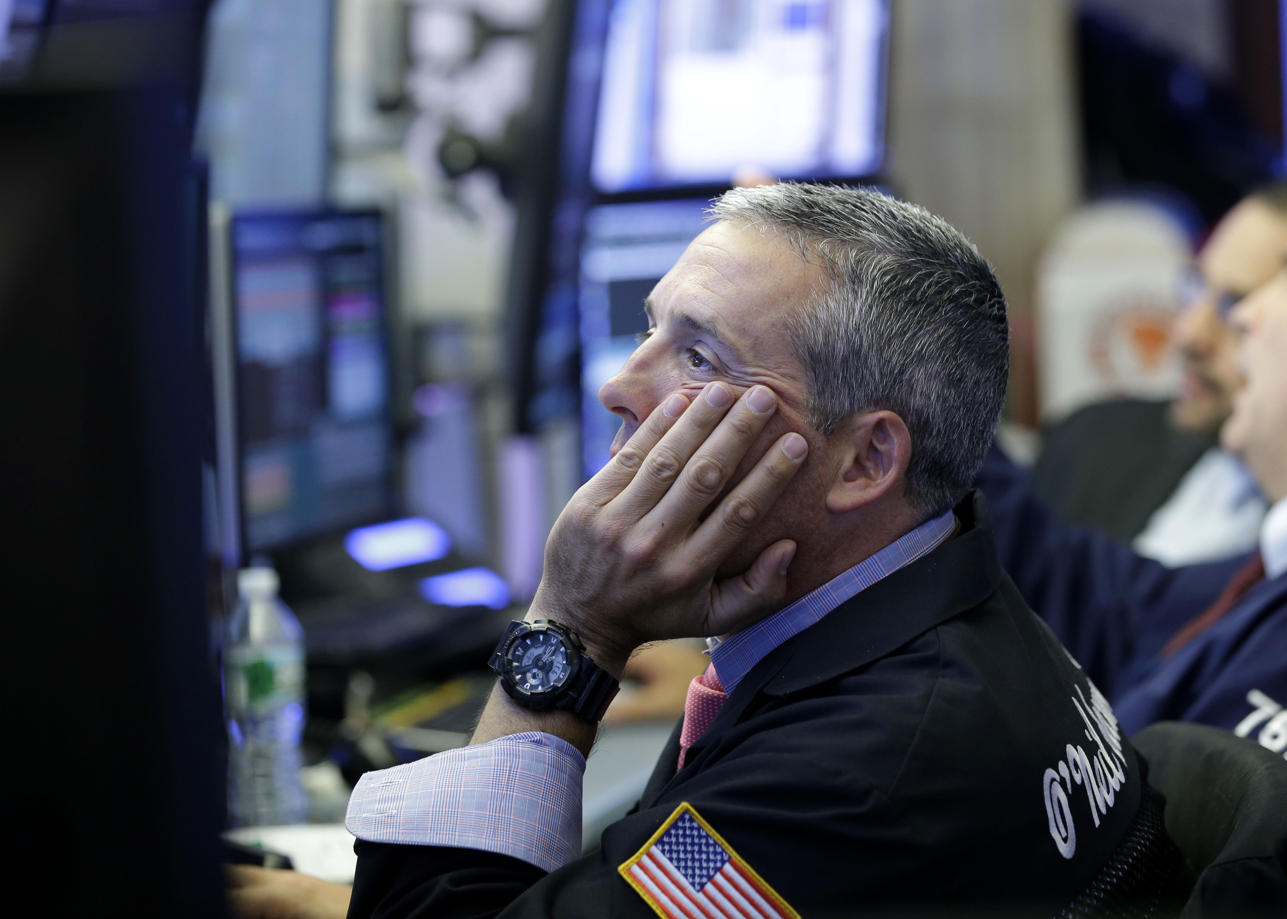 A trader on the floor at the New York Stock Exchange in New York City on July 8, 2015.