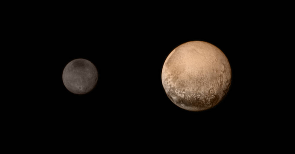 NASA's photos show Pluto, right, and its moon Charon, left.