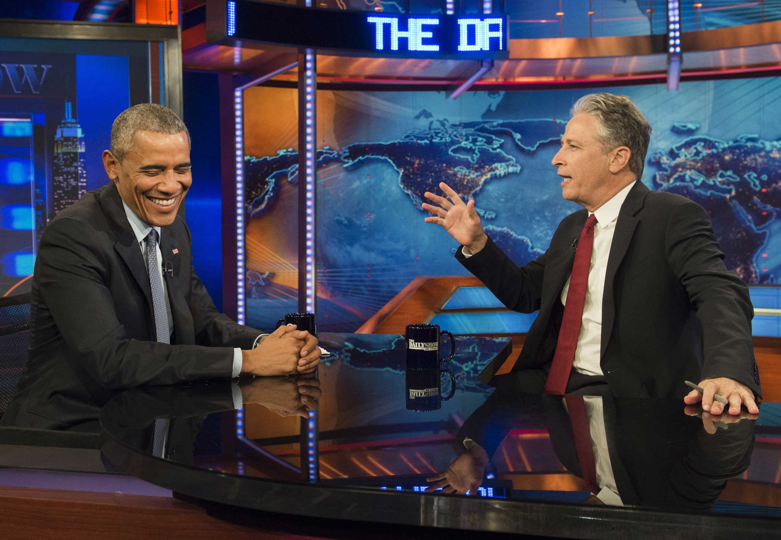 US President Barack Obama speaks with Jon Stewart, host of  The Daily Show with Jon Stewart,  during a taping of the show in New York, July 21, 2015.
