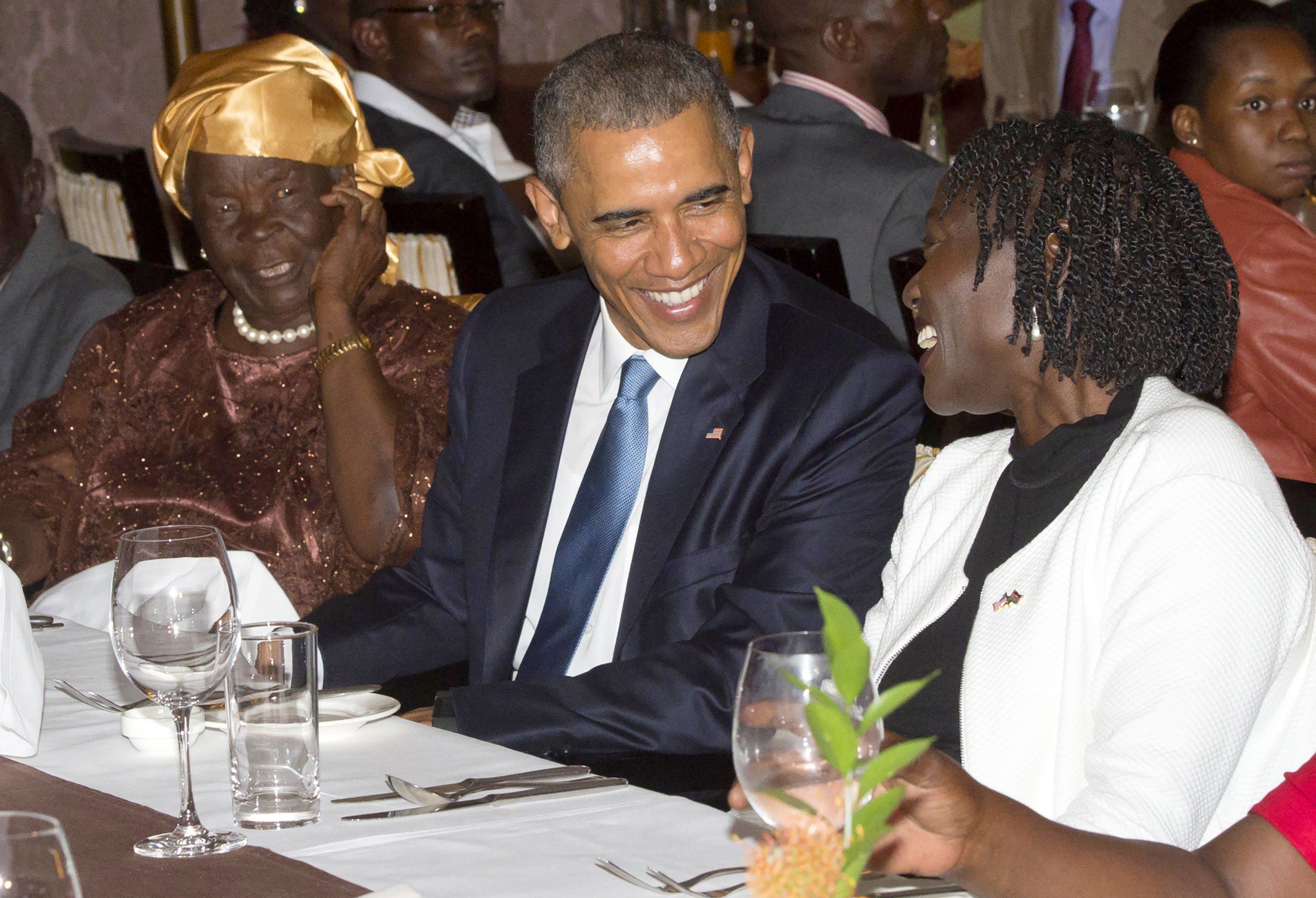 US President Barack Obama sits alongside his step-grandmother, Mama Sarah, left, and half-sister Auma Obama, right, during a gathering of family at his hotel in Nairobi on July 24, 2015.