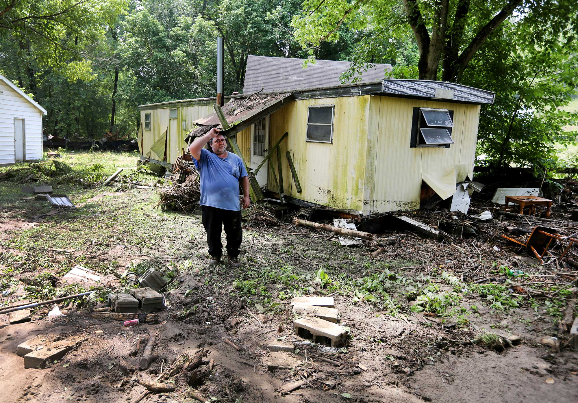 Jeff Downing walks around his property after severe flooding in Ripley, Ohio on July 19, 2015.