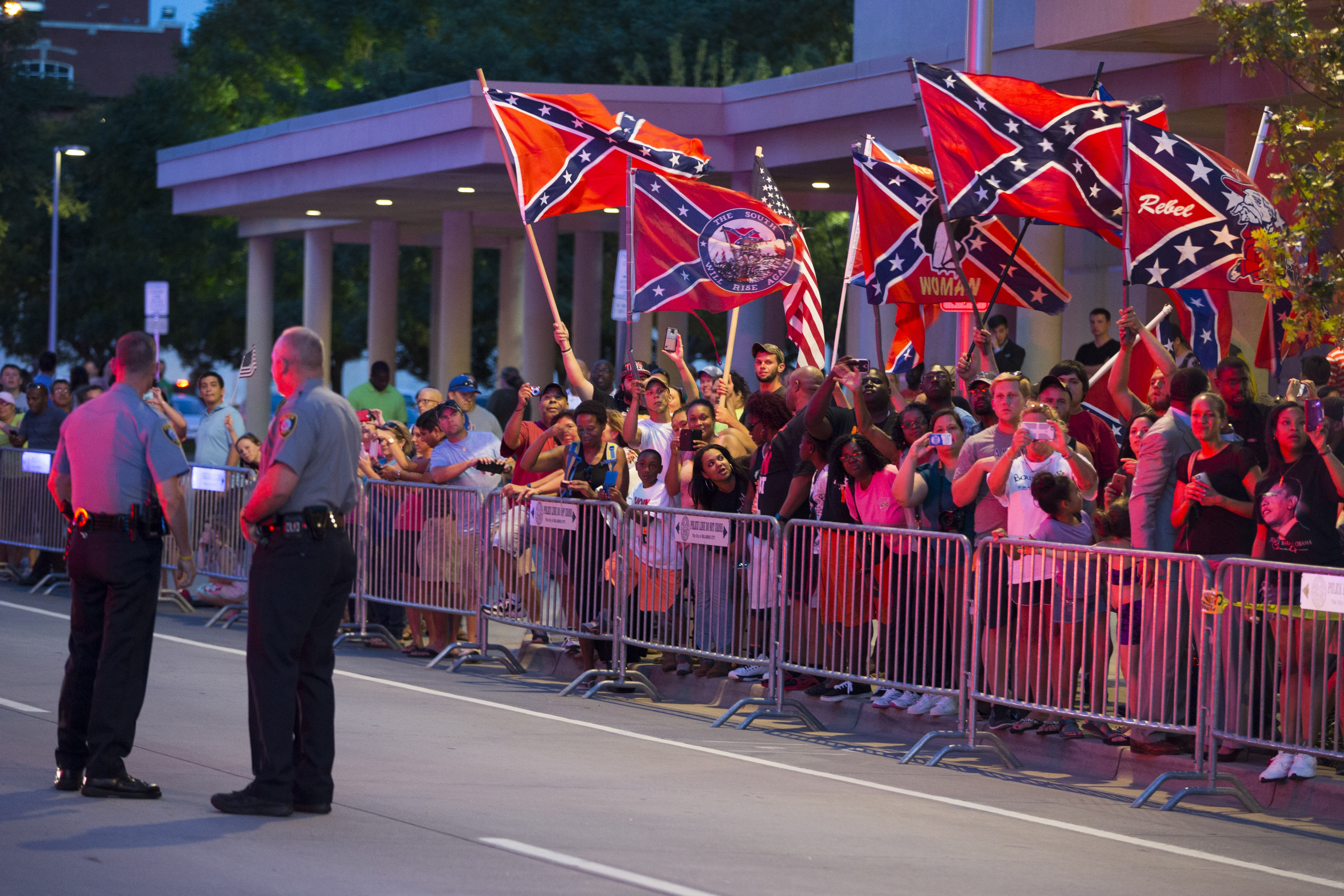 People wave Confederate flags outside the hotel where President Barack Obama is staying on July 15, 2015, in Oklahoma City.