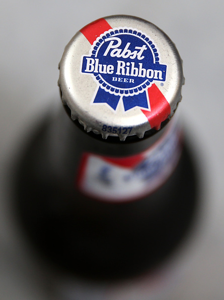 A Pabst Blue Ribbon  beer bottle.