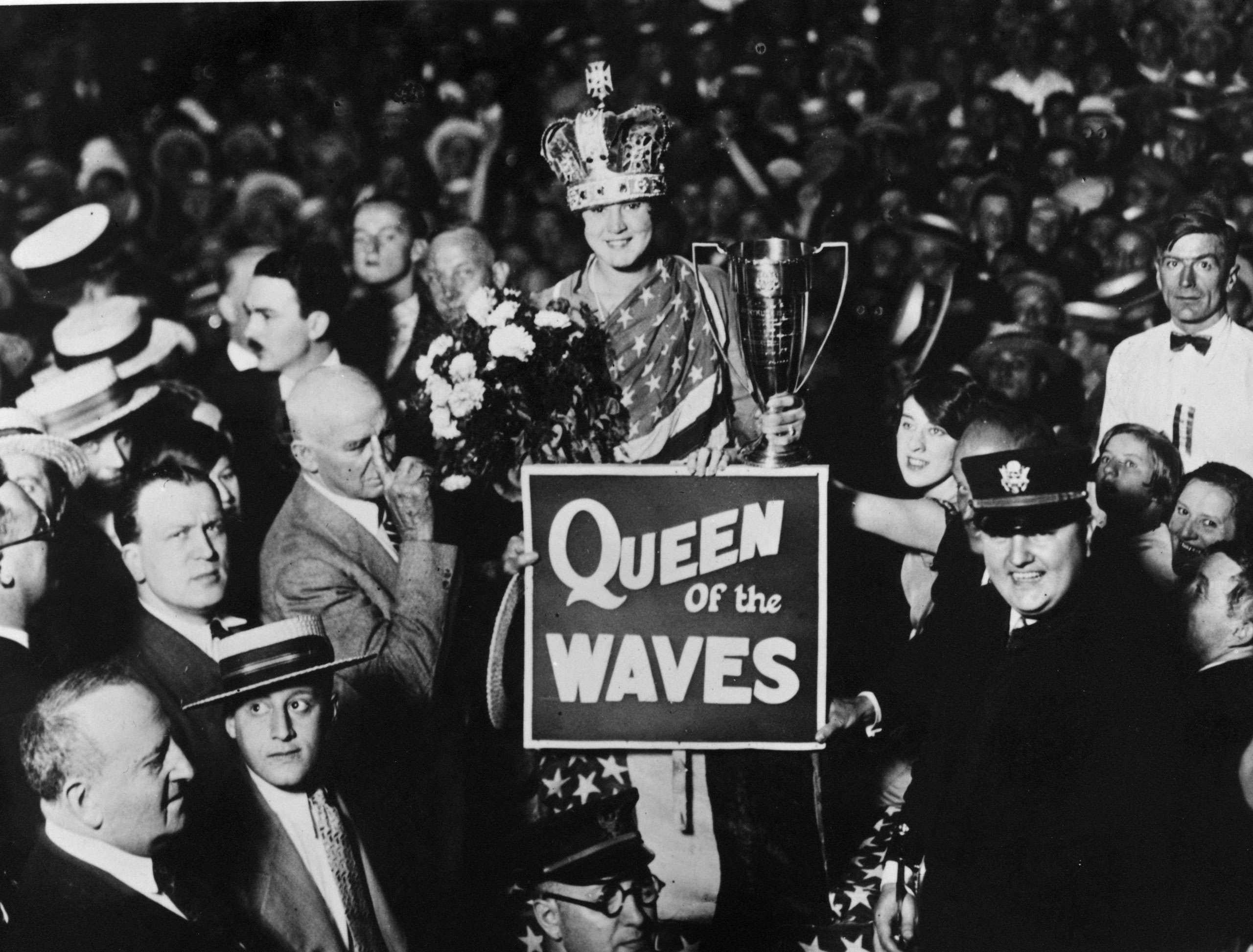 American swimmer Gertrude Ederle, the first female to swim across the English Channel, is crowned 'Queen of the Waves' in New York City on Sept. 8, 1926. The month before, she had been honored with a ticker-tape parade.