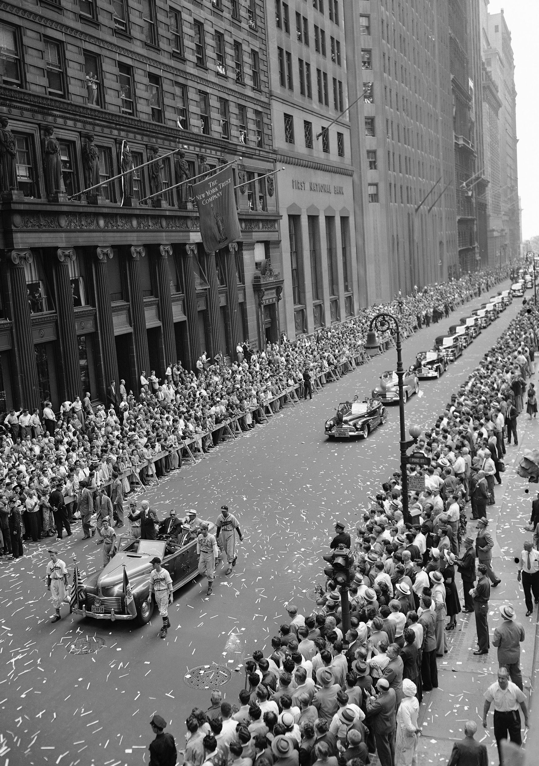 Baseball's Connie Mack stands up in a car to acknowledge the cheers of New Yorkers lining lower Broadway, New York City, on Aug. 19, 1949.
