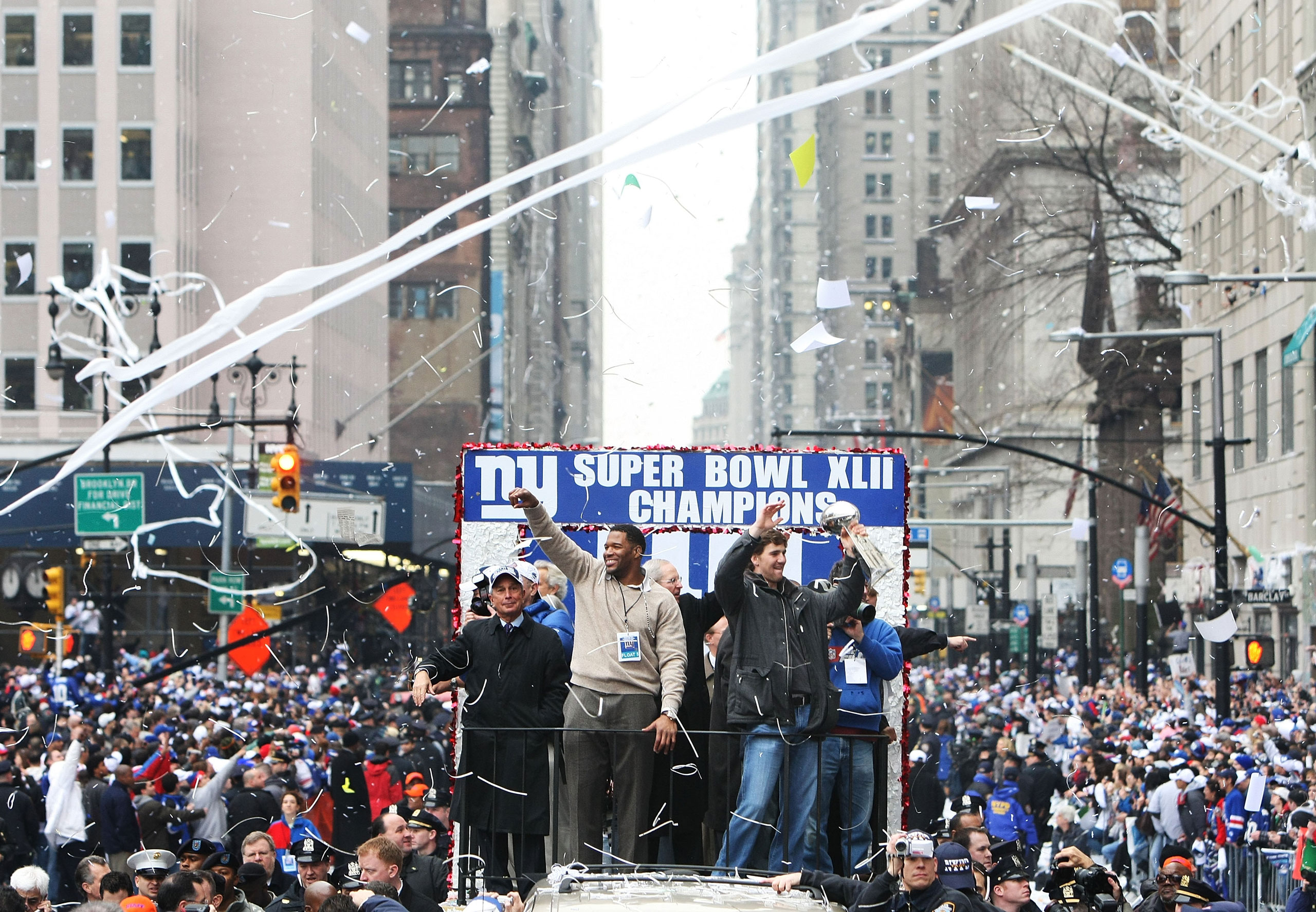 Mayor of New York Michael Bloomberg, with Michael Strahan and Eli Manning of the New York Giants, during the Super Bowl XLII victory parade in New York City on Feb. 5, 2008.