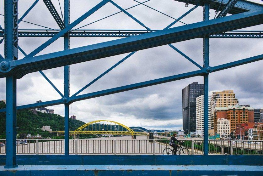 A biker crosses a bridge on June 27, 2015.