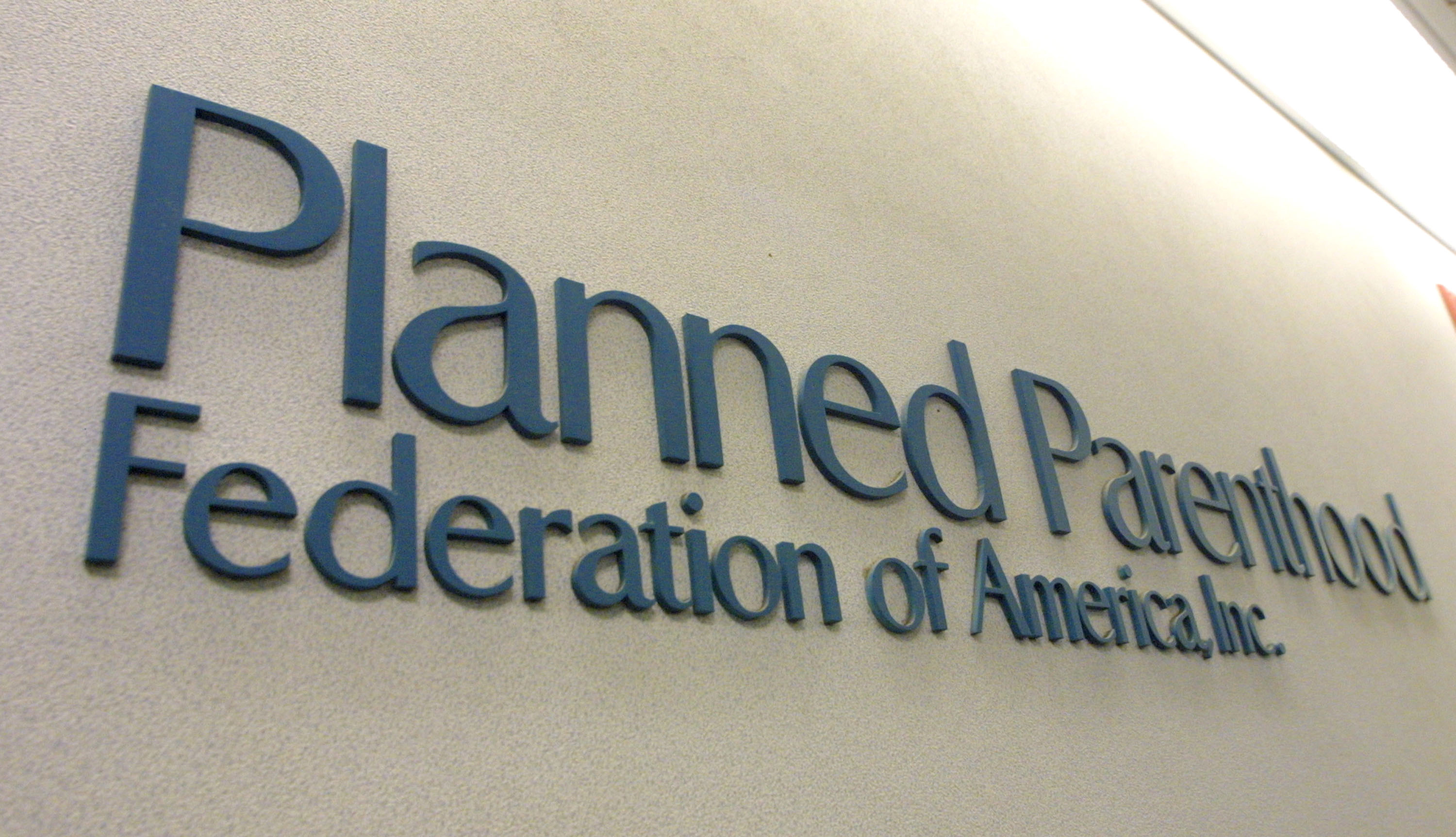 A sign hangs in the offices of the Planned Parenthood Federation of America December 7, 2001 in New York City.