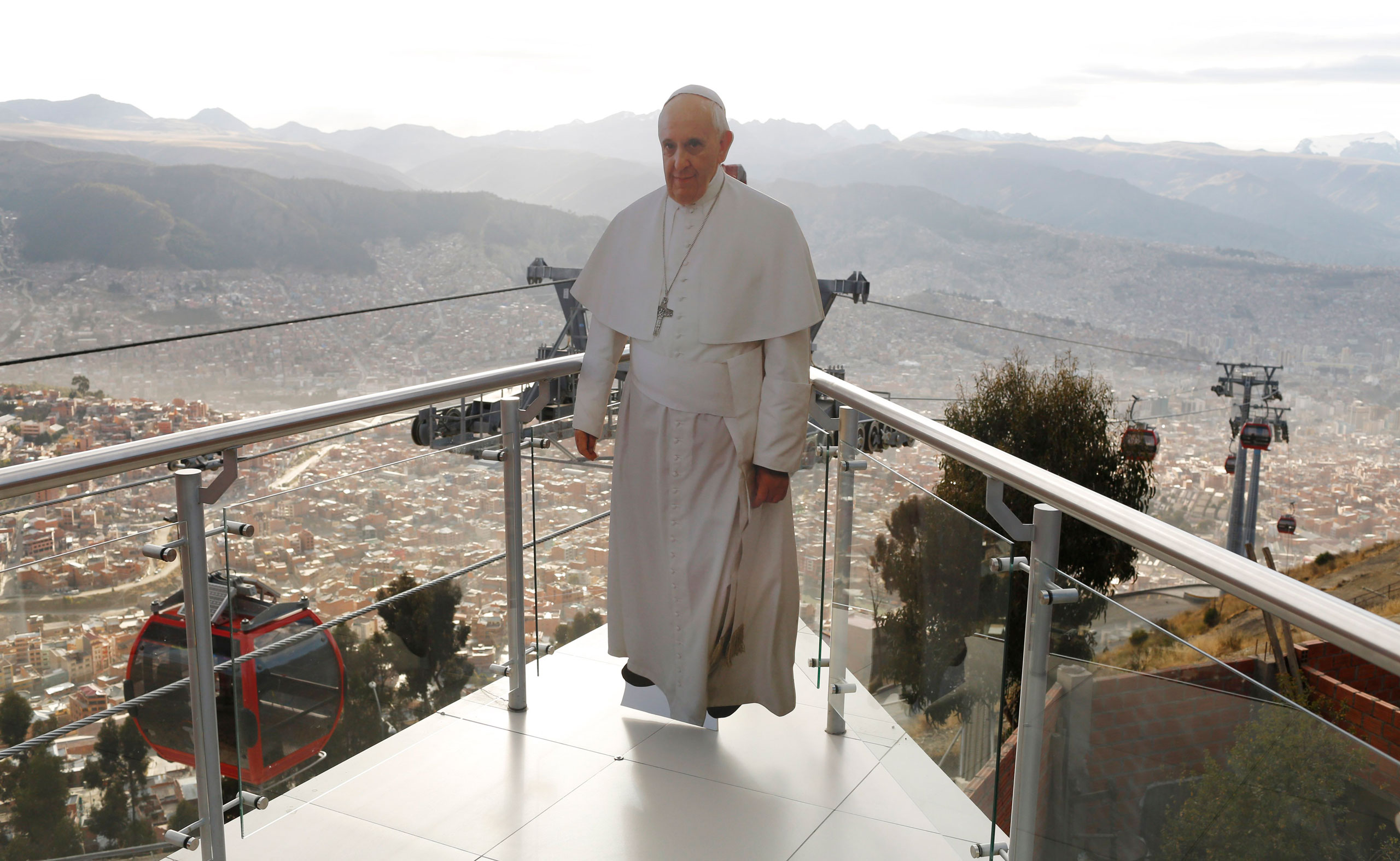 A life-size cutout image of Pope Francis stands on the cable car platform in El Alto, overlooking La Paz, Bolivia, on July 3, 2015.