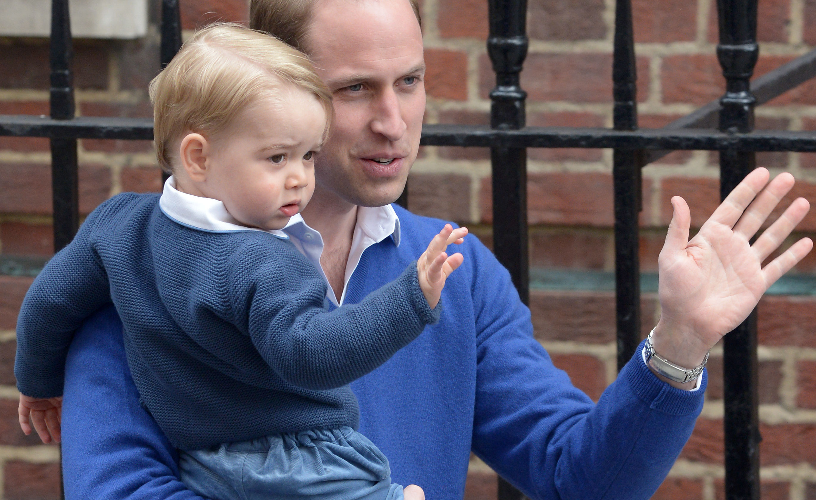 File photo dated May 2, 2015 of the Duke of Cambridge with his son Prince George as he arrives at the Lindo Wing of St Mary's Hospital in London, after the birth of his newborn daughter Princess Charlotte.