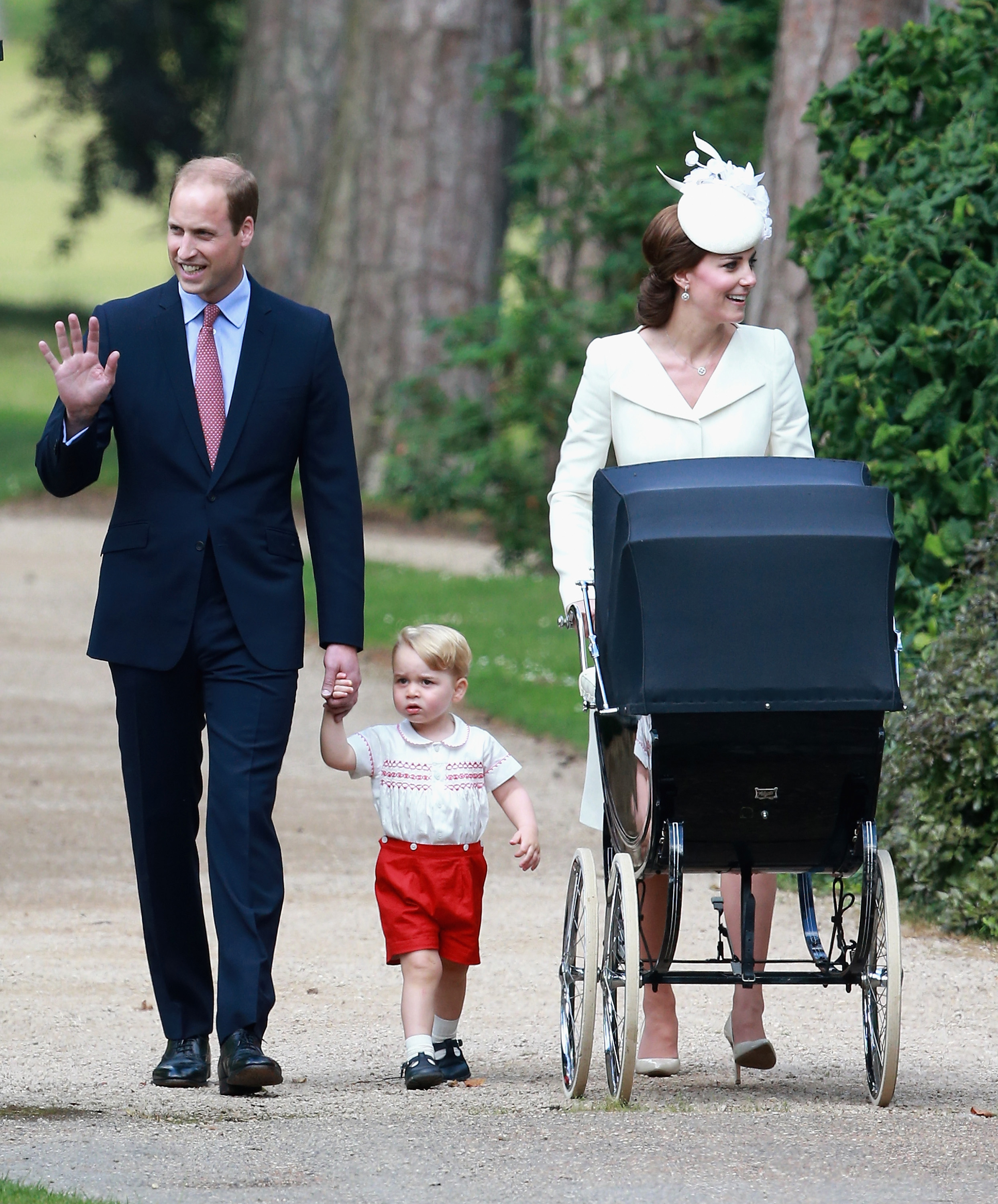 Catherine, Duchess of Cambridge, Prince William, Duke of Cambridge, Princess Charlotte of Cambridge and Prince George of Cambridge arrive at the Church of St Mary Magdalene on the Sandringham Estate for the Christening of Princess Charlotte of Cambridge on July 5, 2015 in King's Lynn, England.
