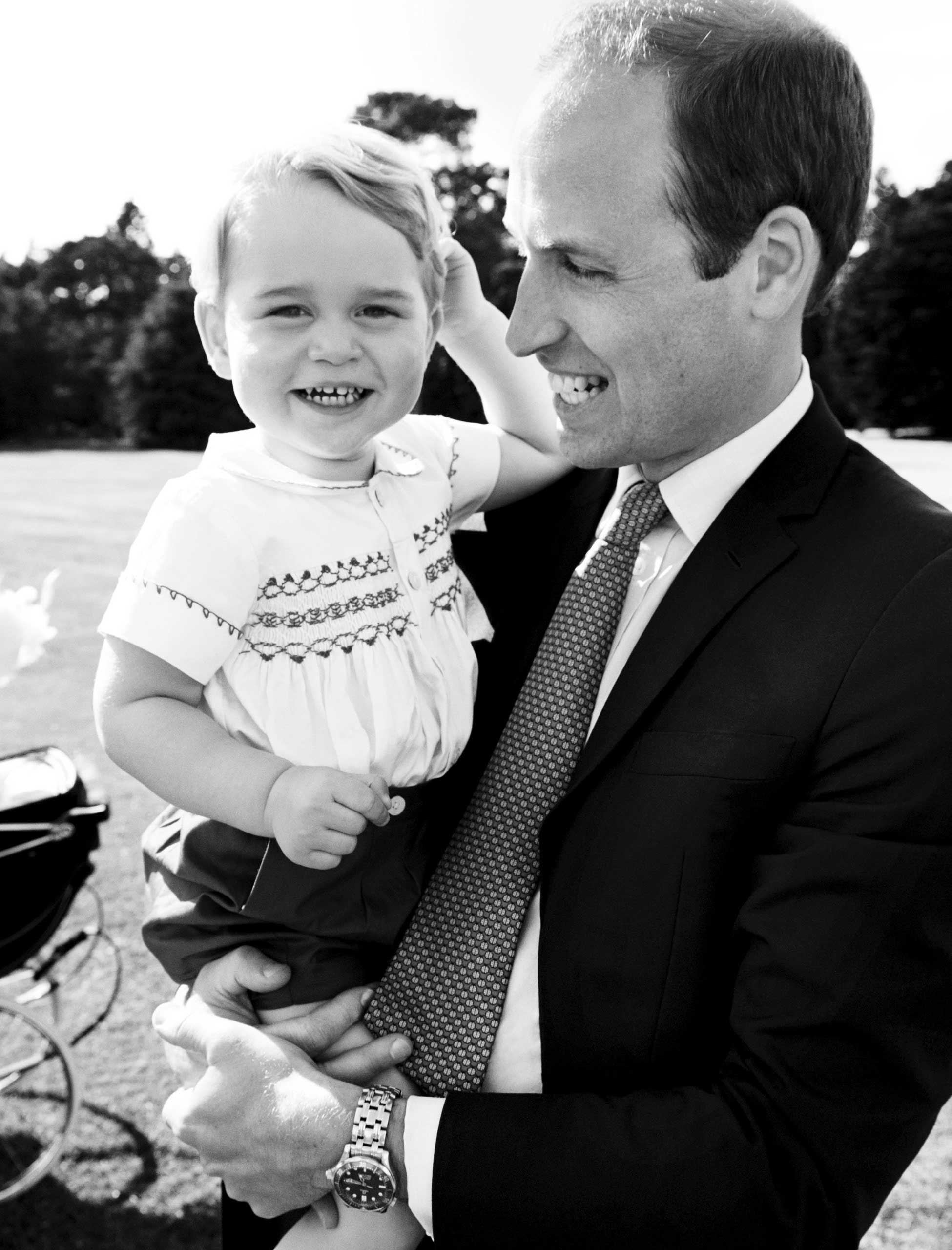 Britain's Prince William holds his son, Prince George, after the christening of Princess Charlotte of Cambridge at Sandringham, United Kingdom.