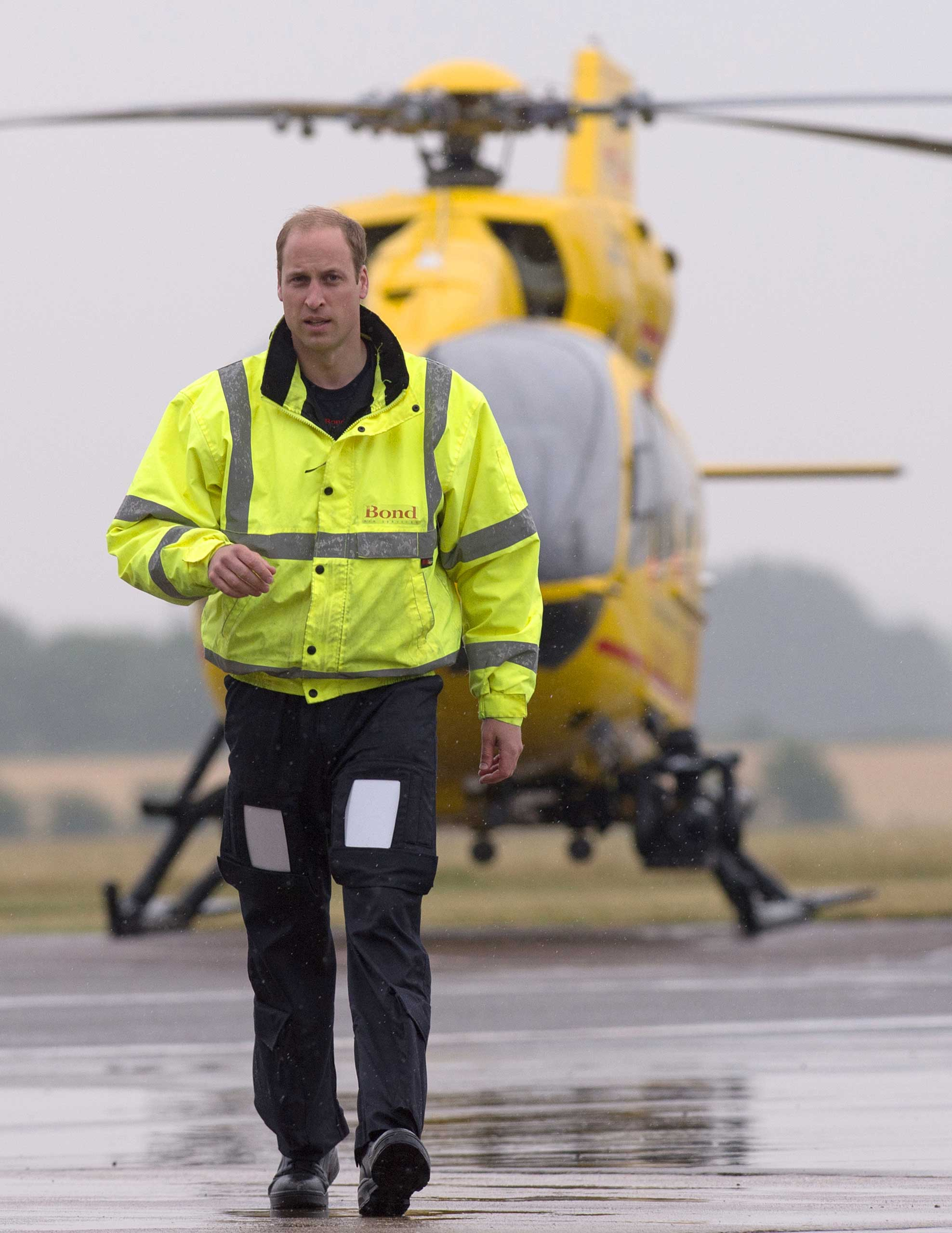 Prince William, The Duke of Cambridge as he begins his new job with the East Anglian Air Ambulance (EAAA) at Cambridge Airport on July 13, 2015 in Cambridge, England.