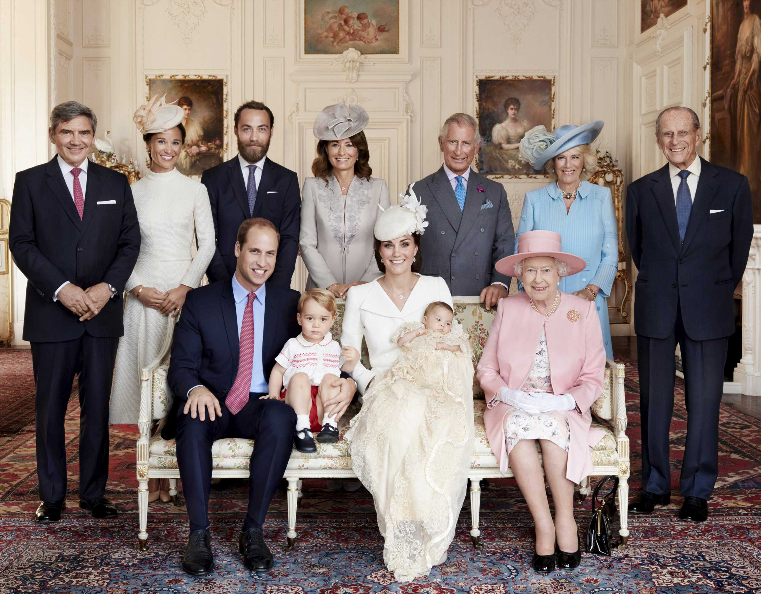Britain's Prince William, Prince George, Catherine, Duchess of Cambridge, Princess Charlotte, Queen Elizabeth, andMichael Middleton, Pippa Middleton, James Middleton, Carole Middleton, Prince Charles, Camilla, Duchess of Cornwall, and Prince Philip,  pose for a photo in the Drawing Room of Sandringham House, following the christening of Princess Charlotte.