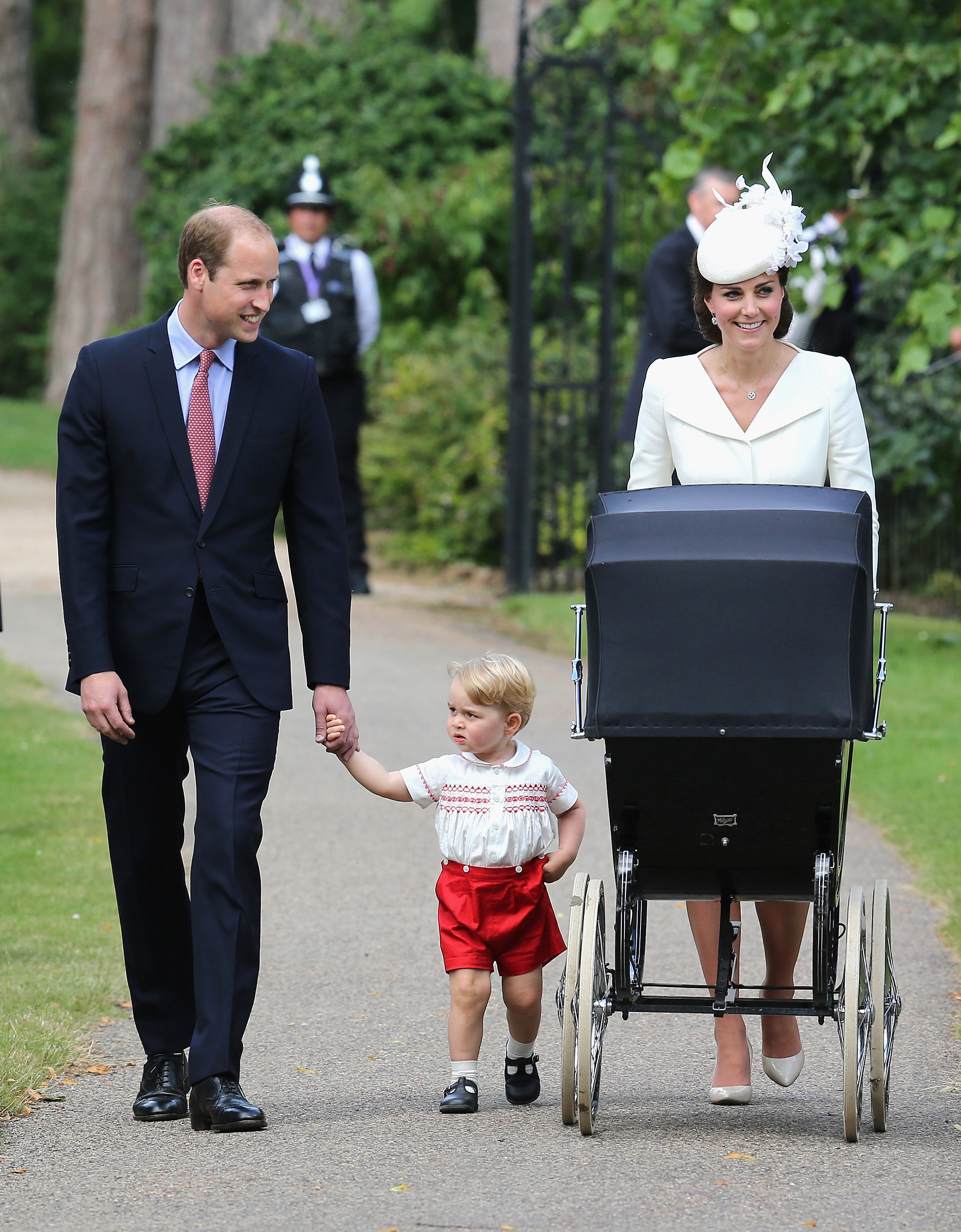 Britain's Prince William, Kate the Duchess of Cambridge, their son Prince George and daughter Princess Charlotte in a pram arrive for Charlotte's Christening at St. Mary Magdalene Church in Sandringham, England on July 5, 2015.