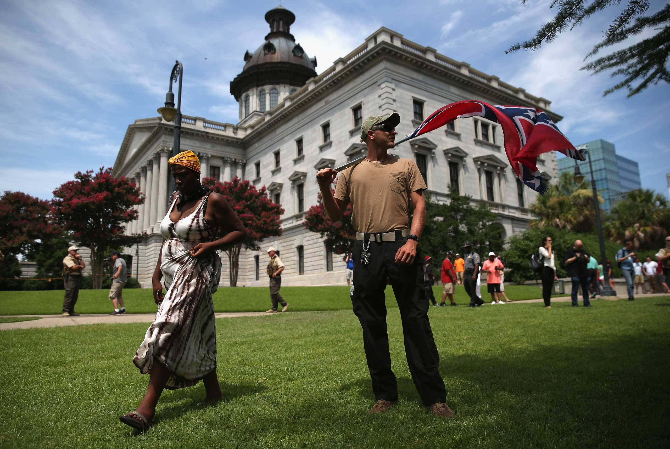 A man holds a Confederate flag on the state house grounds in Columbia, S.C. on July 18, 2015.