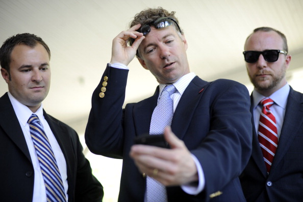 In this file photo, Dr. Rand Paul looks at a campaign ad on his phone while running for the U.S. Senate.
