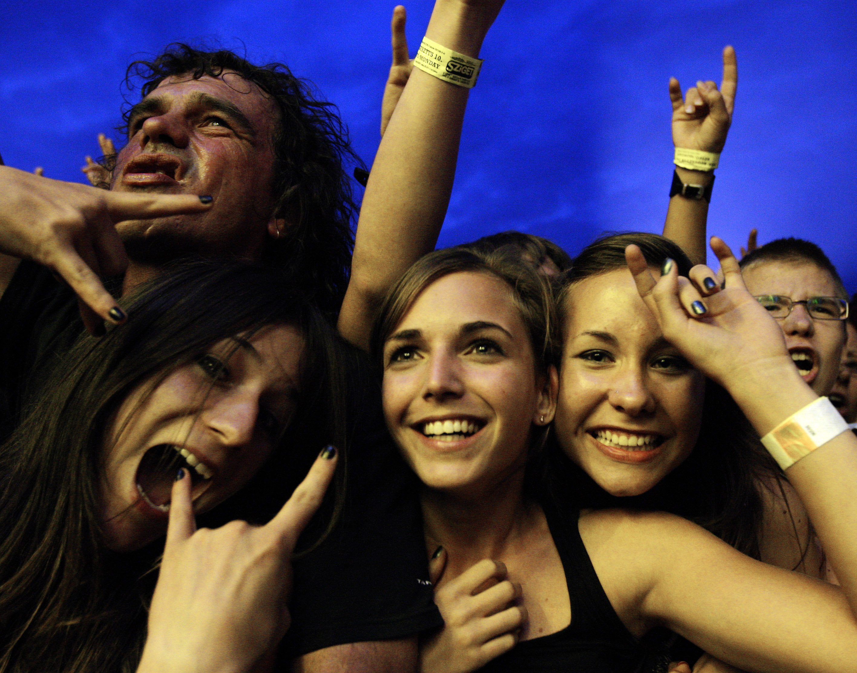 Revellers attend a concert by Hungarian metal band  Tankcsapda  during Budapest's one-week, round-the-clock Sziget ('Island') music festival on an island in the Danube river August 10, 2009.