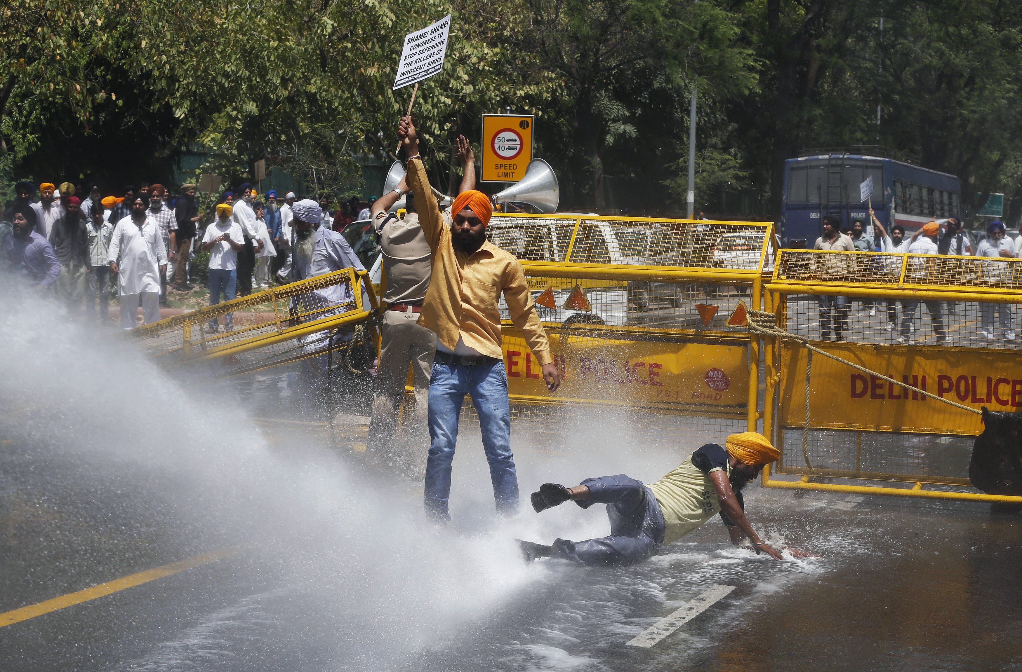 Police use a water cannon to disperse Sikh protesters during a demonstration in front of India's ruling Congress Party headquarters in New Delhi on April 21, 2014