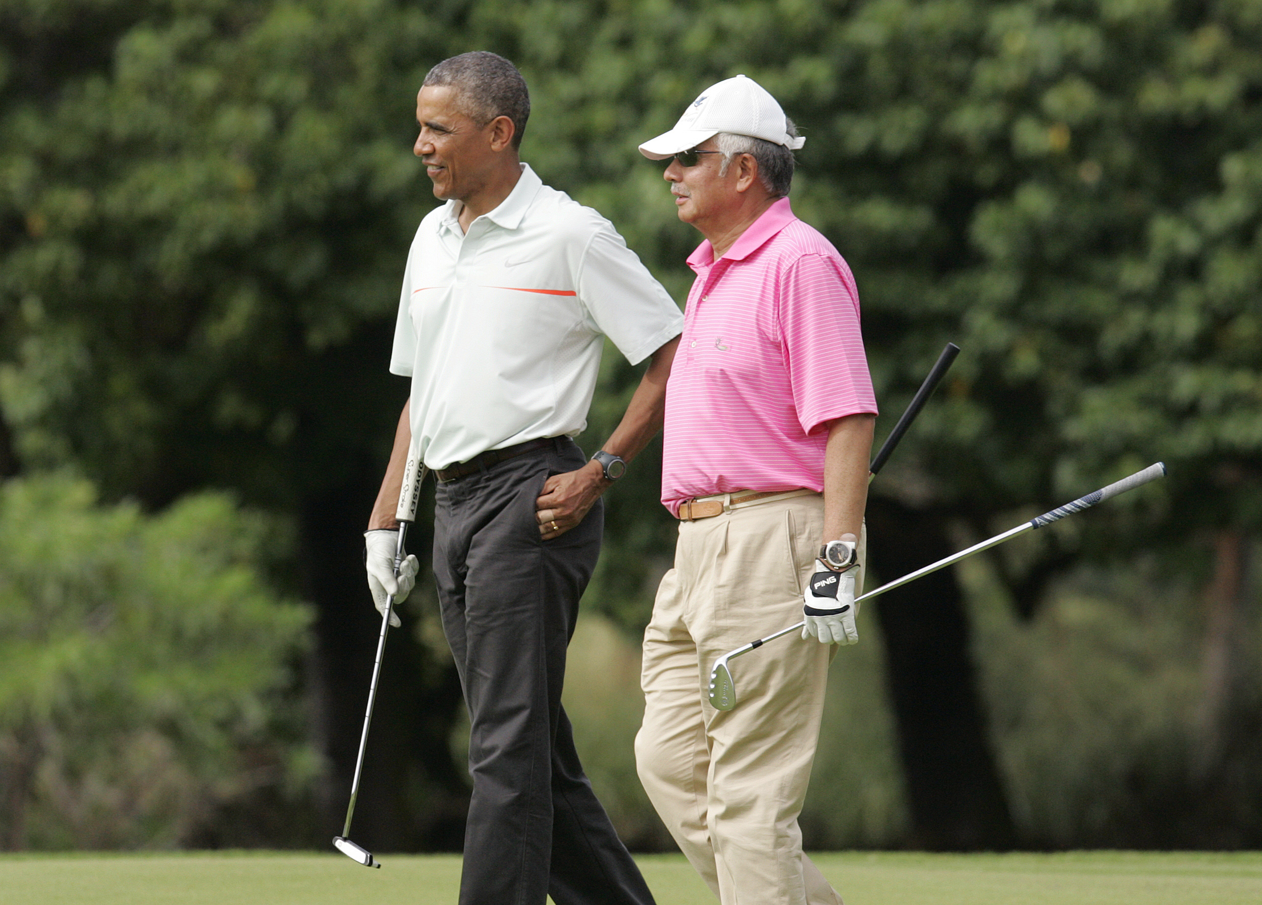 U.S. President Barack Obama and Malaysia's Prime Minister Najib Razak walk off 18th hole while playing a round of golf at the Clipper Golf course on Marine Corps Base Hawaii during Obama's Christmas holiday vacation in Kaneohe, Hawaii, on Dec. 24, 2014