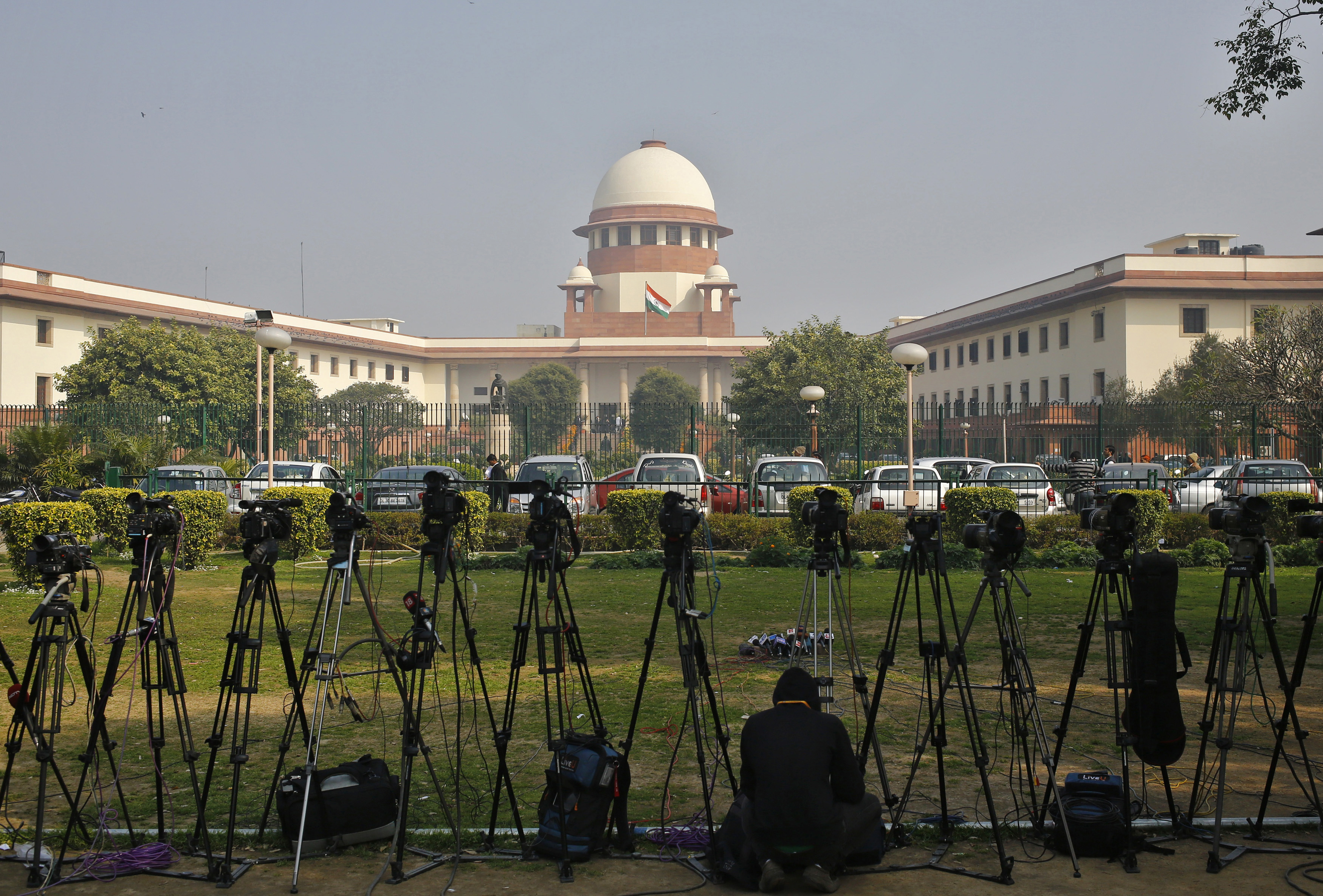 A television journalist sets his camera inside the premises of the Supreme Court in New Delhi on Feb. 18, 2014