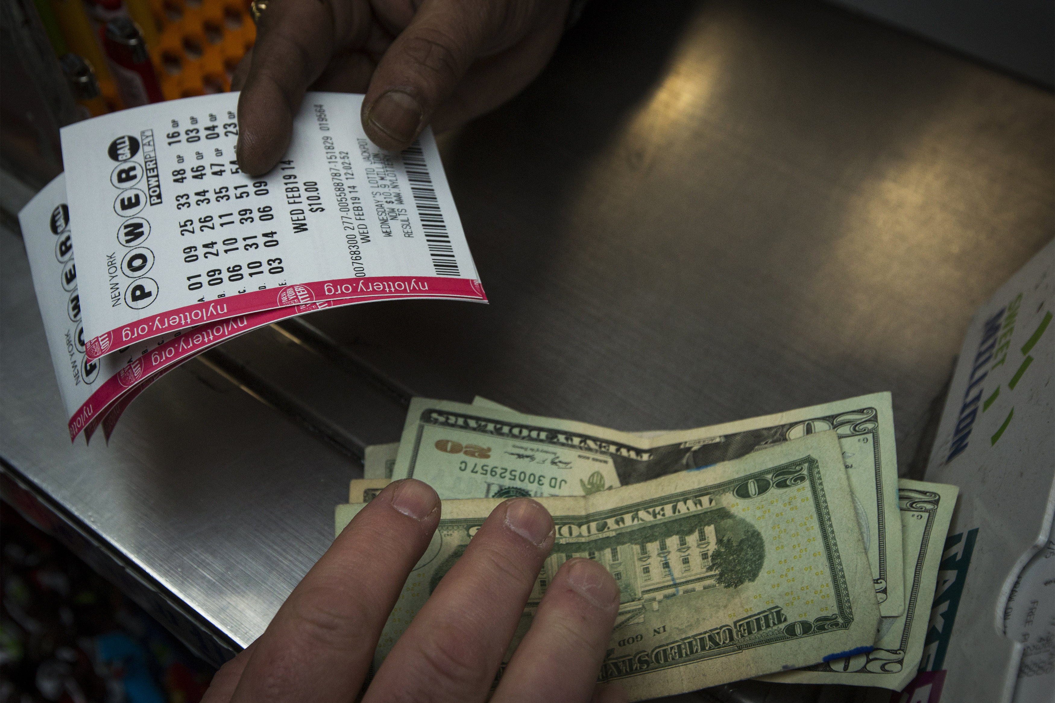 A man purchases New York State Lottery tickets.